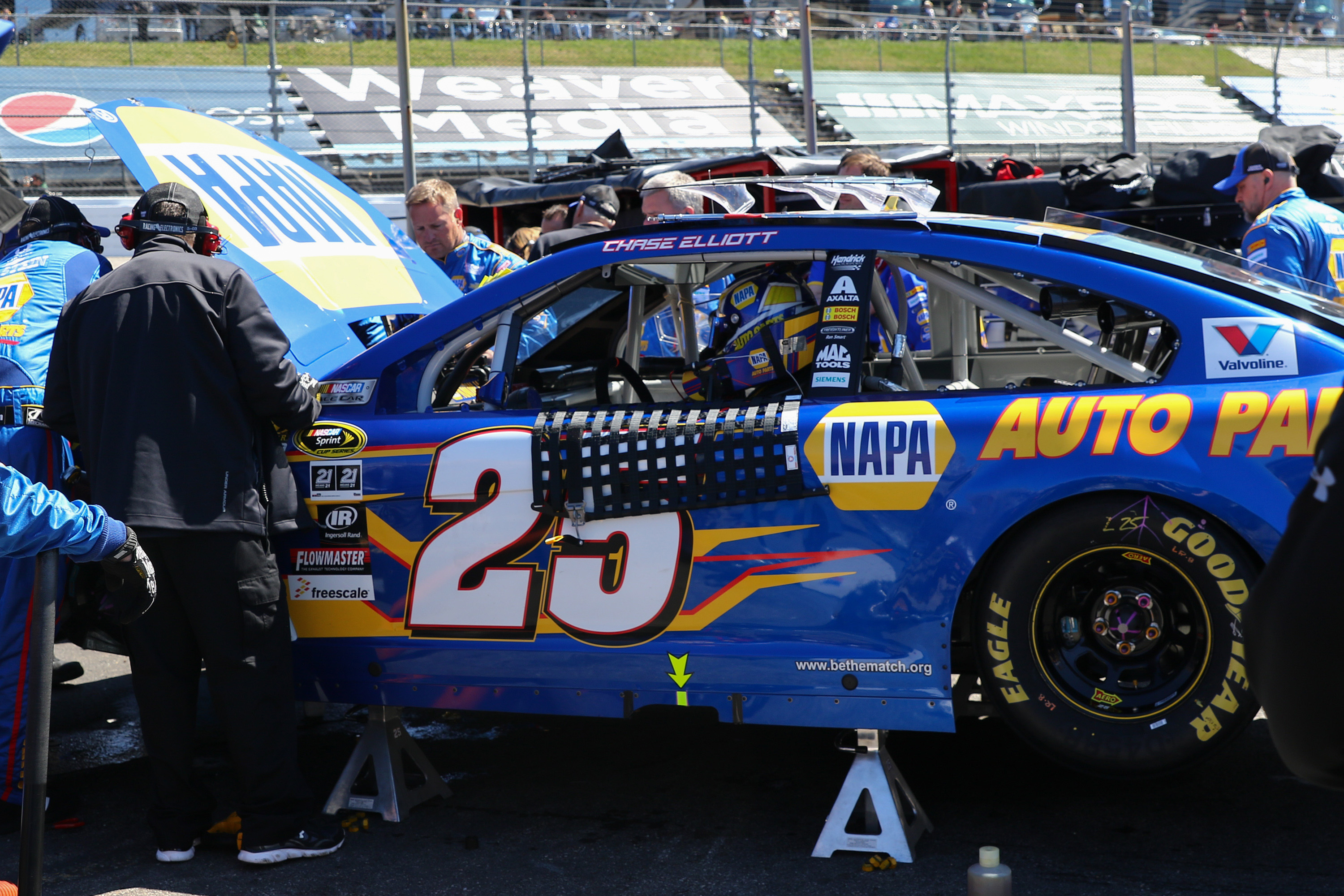 Mar 29, 2015; Martinsville, VA, USA; Sprint Cup Series driver Chase Elliott (25) waits as his car is repaired during the STP 500 at Martinsville Speedway. (Randy Sartin-USA TODAY Sports)