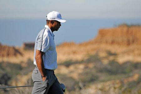 Feb 5, 2015; La Jolla, CA, USA; Tiger Woods walks up the 13th during the first round of the Farmers Insurance Open golf tournament at Torrey Pines Municipal Golf Course - South Co. Mandatory Credit: Jake Roth-USA TODAY Sports