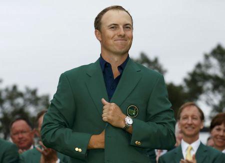 Jordan Spieth smiles as he wears his green jacket. (REUTERS)