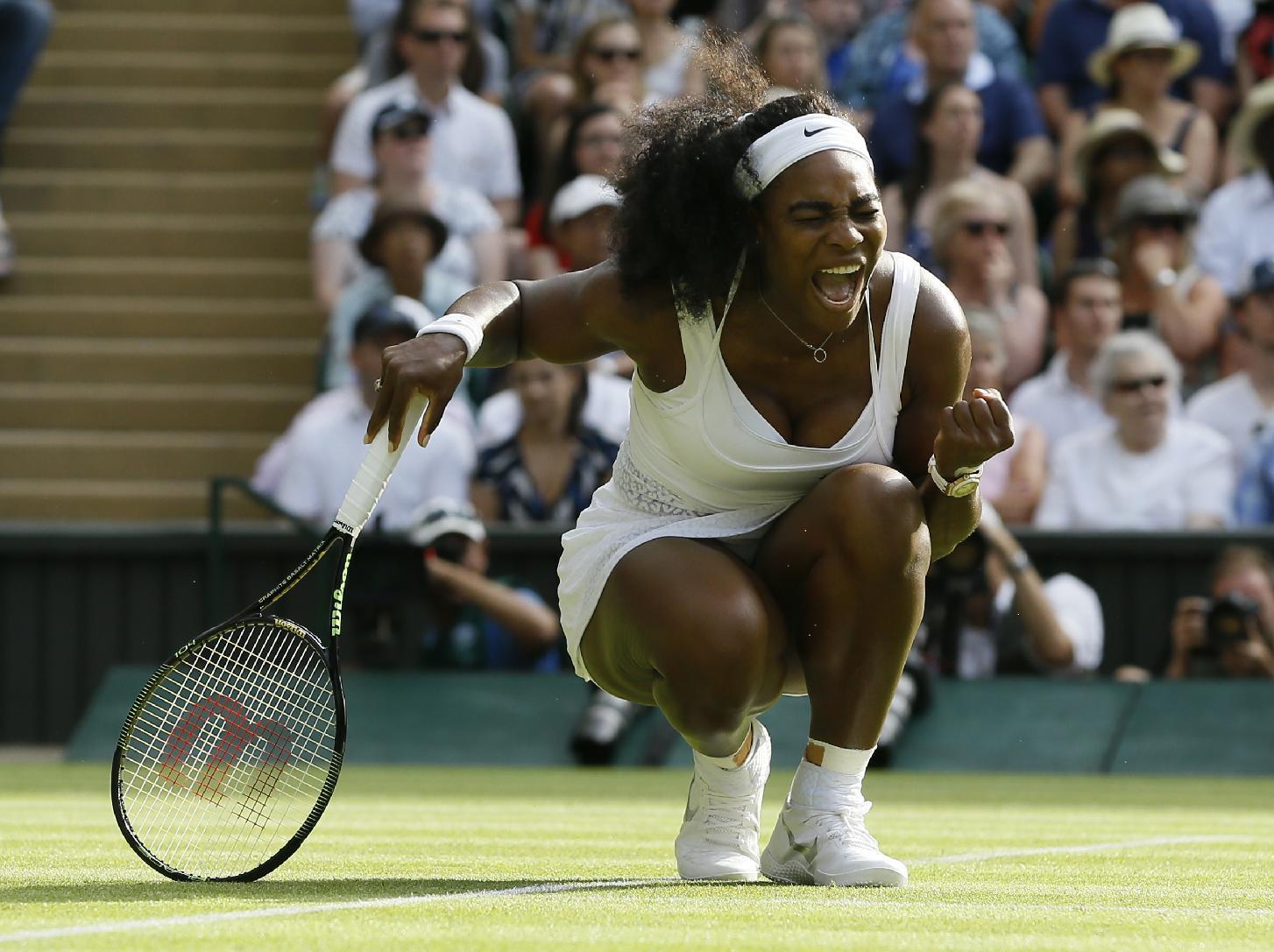 Serena Williams celebrates winning a point against Heather Watson. (AP)