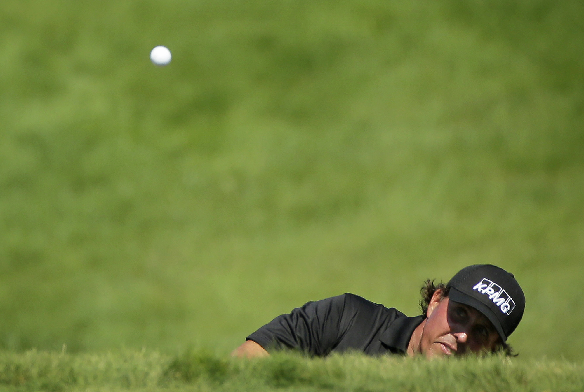 Phil Mickelson hits on the 18th hole during the third round of the PGA Championship. (AP)