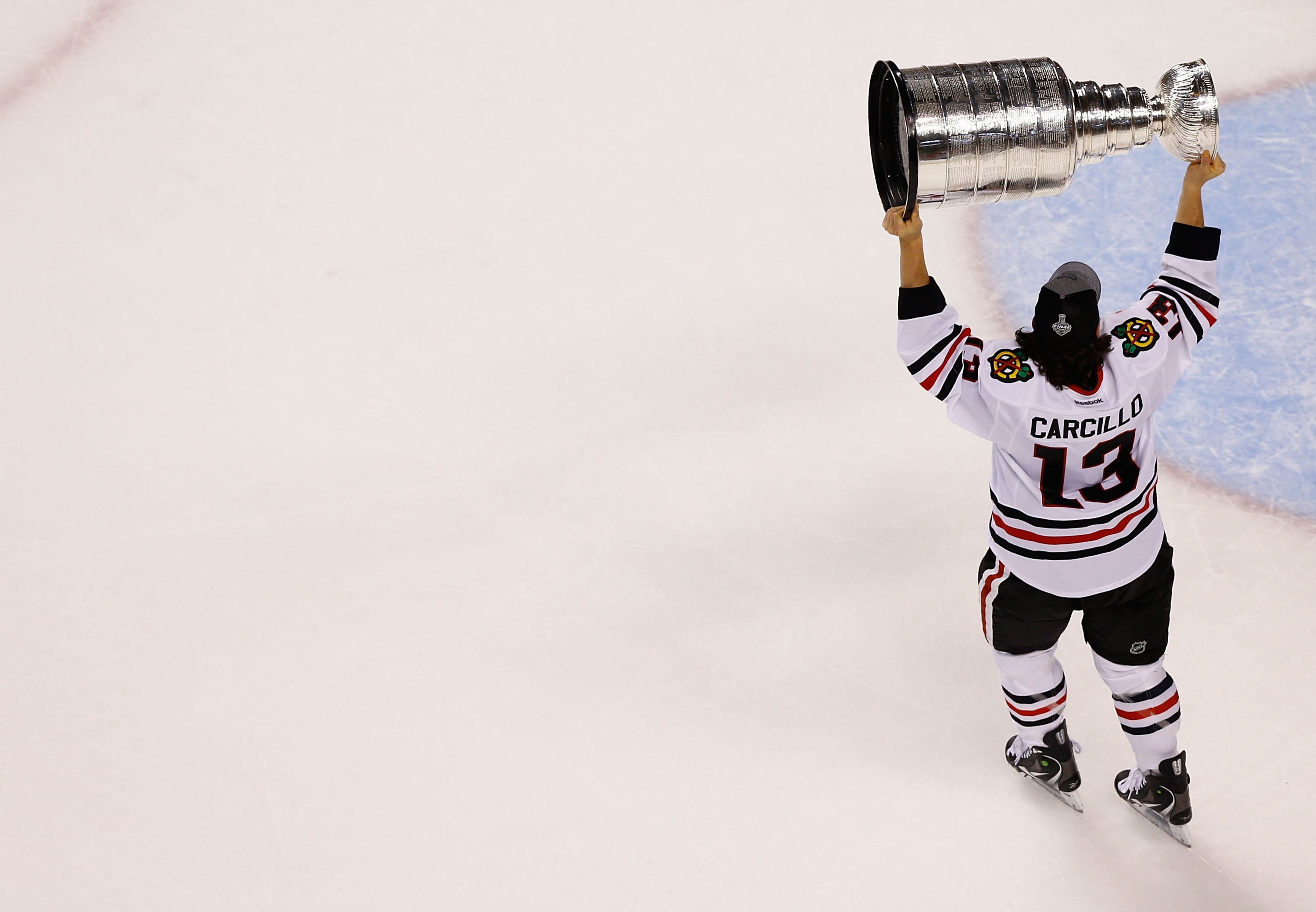 Daniel Carcillo  13 of the Chicago Blackhawks carries the Stanley Cup  following their 3- bfee0b646
