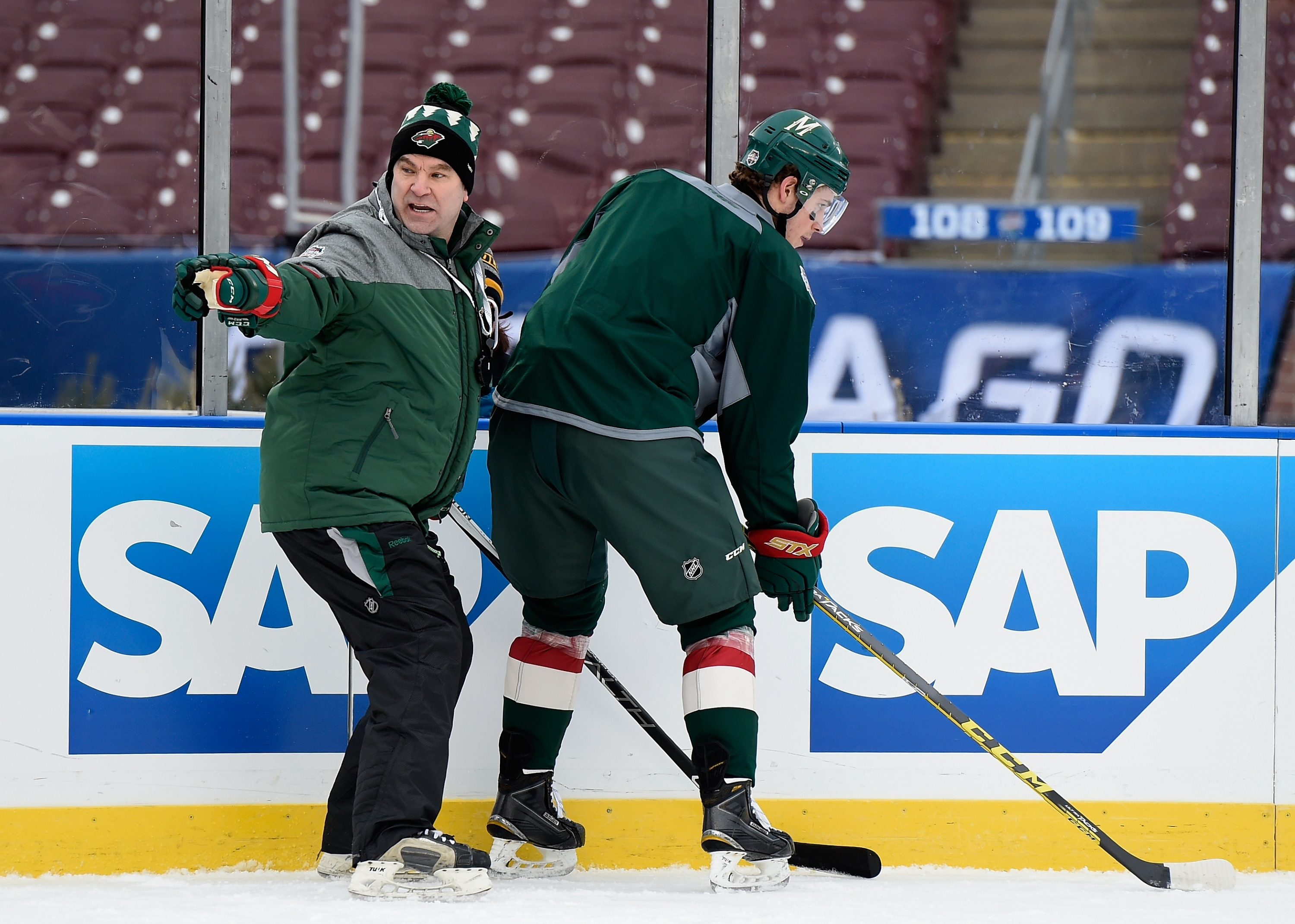 MINNEAPOLIS, MN - FEBRUARY 20: Interim head coach John Torchetti of the Minnesota Wild speaks to Charlie Coyle #3 during practice day at the 2016 Coors Light Stadium Series on February 20, 2016 at TCF Bank Stadium in Minneapolis, Minnesota. (Photo by Hannah Foslien/Getty Images)