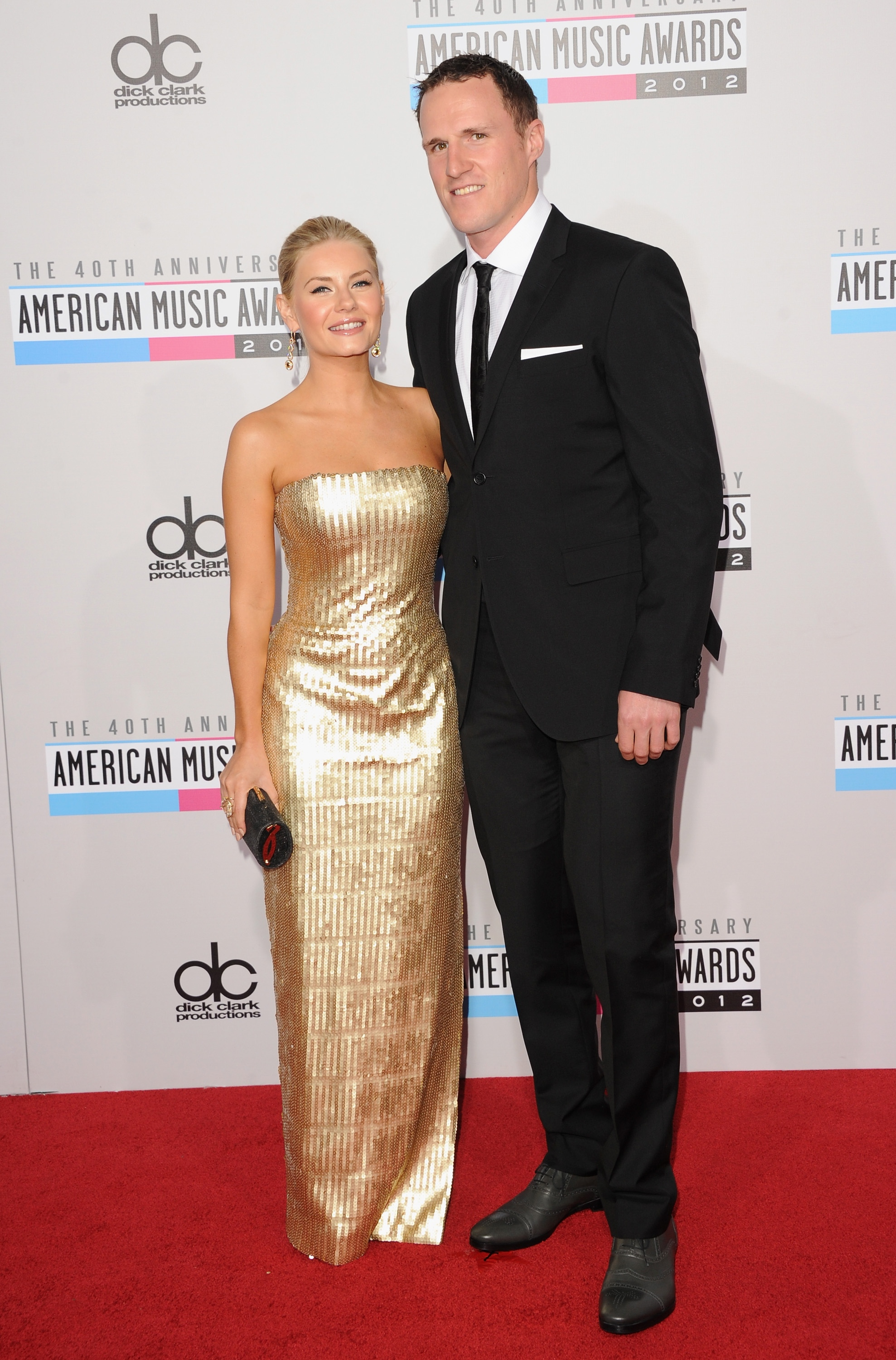 LOS ANGELES, CA - NOVEMBER 18:  Actress Elisha Cuthbert and athlete Dion Phaneuf attend the 40th American Music Awards held at Nokia Theatre L.A. Live on November 18, 2012 in Los Angeles, California.  (Photo by Jason Merritt/Getty Images)
