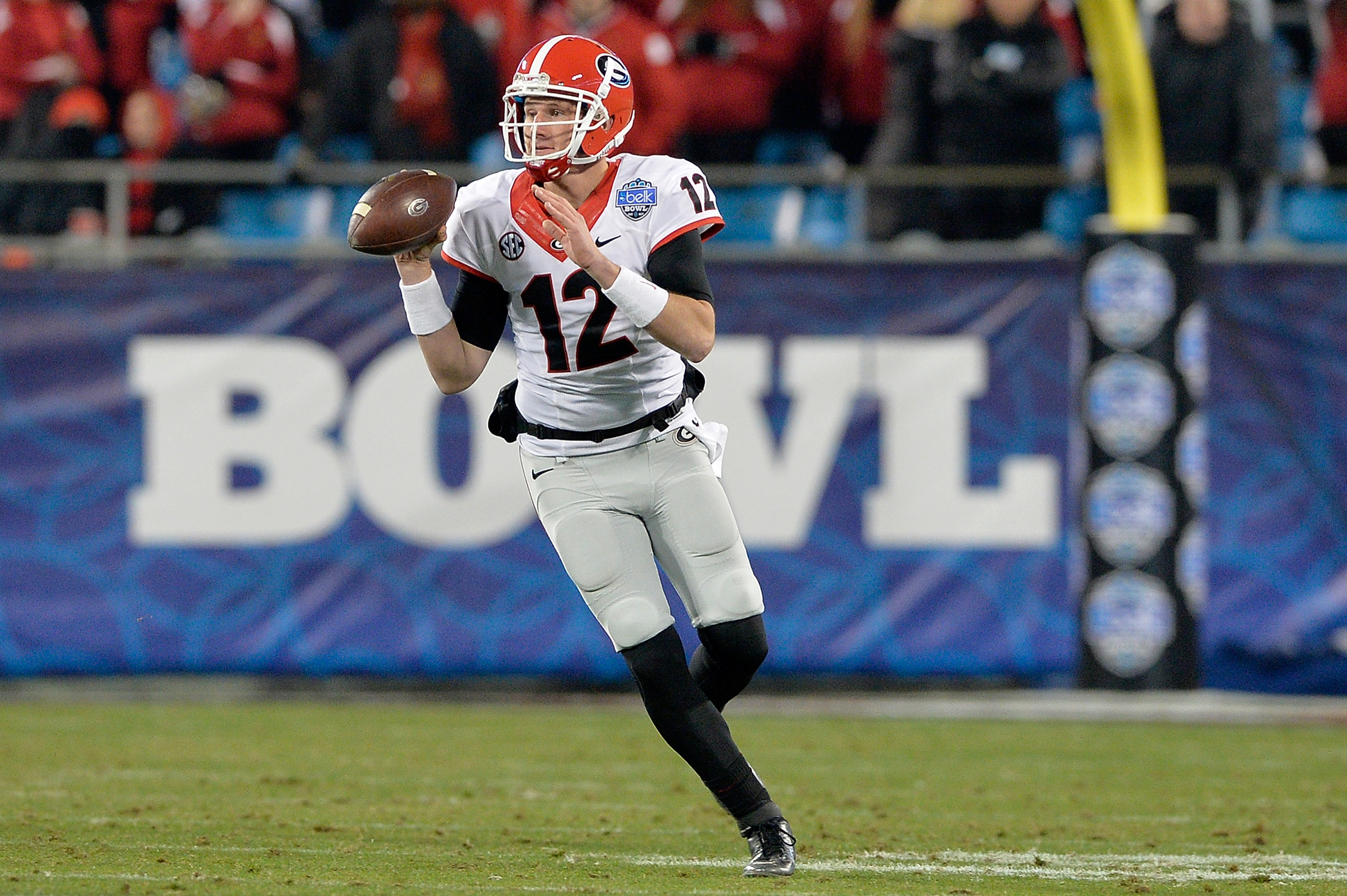 Brice Ramsey #12 rolls out against Louisville during the Belk Bowl at Bank of America Stadium on December 30, 2014 in Charlotte, North Carolina. (Photo by Grant Halverson/Getty Images)