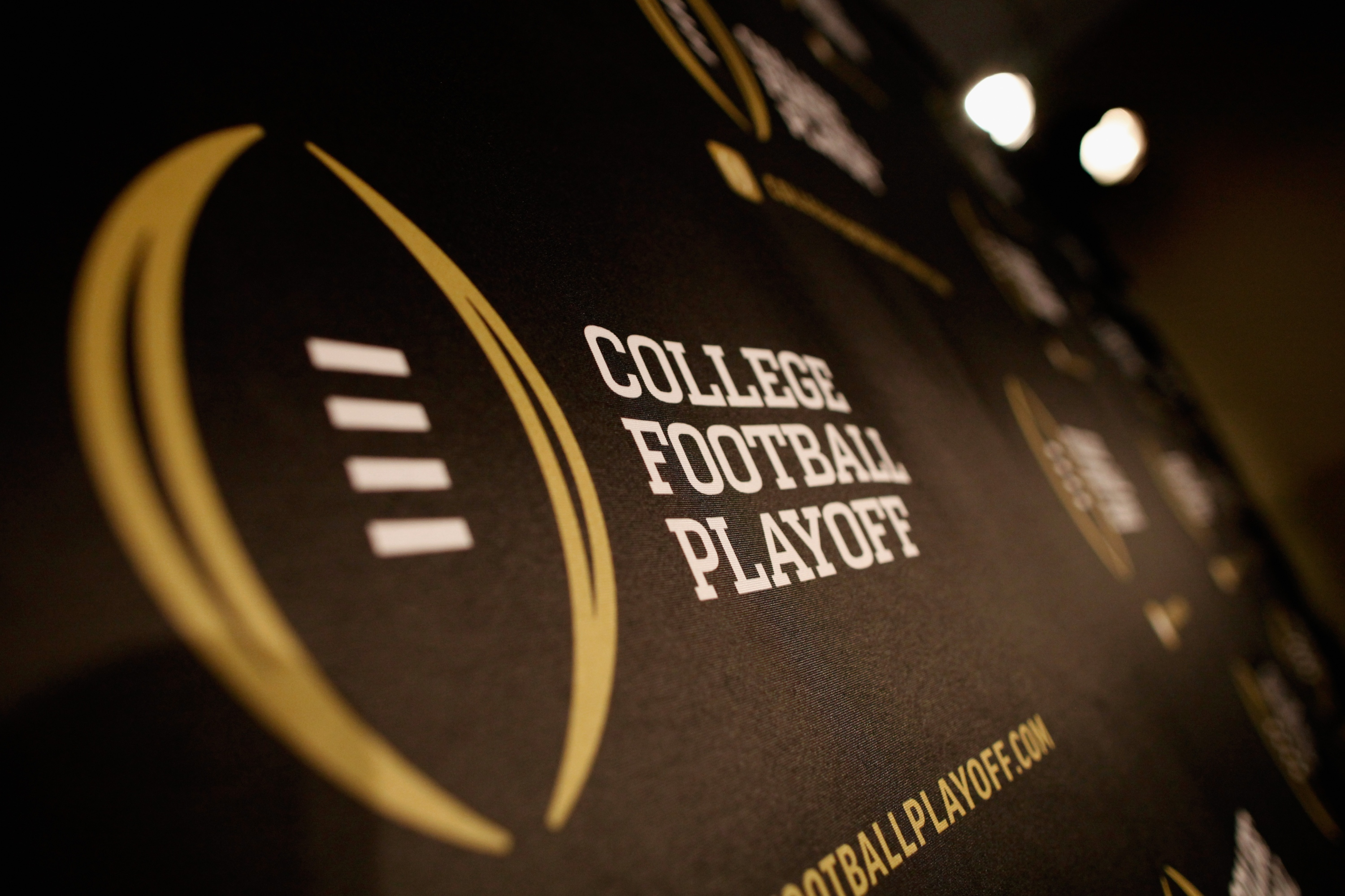 IRVING, TX - OCTOBER 16: A detail view of the College Football Playoff logo shown during a press conference on October 16, 2013 in Irving, Texas. (Photo by Tom Pennington/Getty Images)