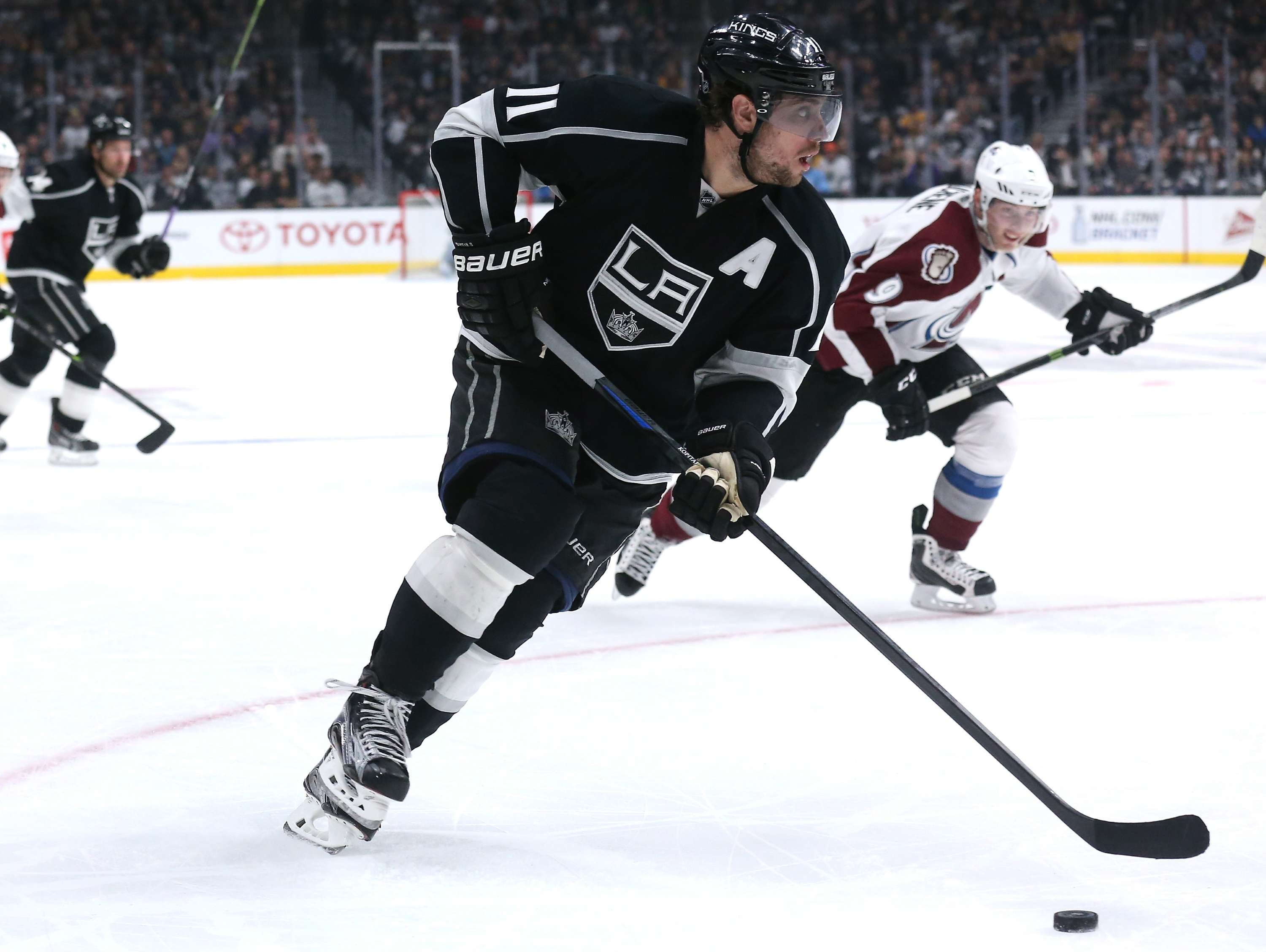 LOS ANGELES, CA - APRIL 04:   Anze Kopitar #11 of the Los Angeles Kings skates with the puck against the Colorado Avalanche at Staples Center on April 4, 2015 in Los Angeles, California.  (Photo by Stephen Dunn/Getty Images)