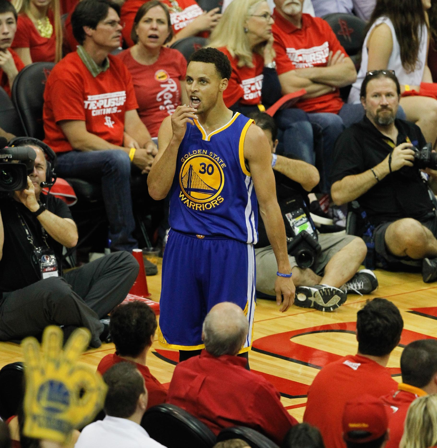 Stephen Curry stares down the crowd after drilling a corner 3. (Bob Levey/Getty Images)