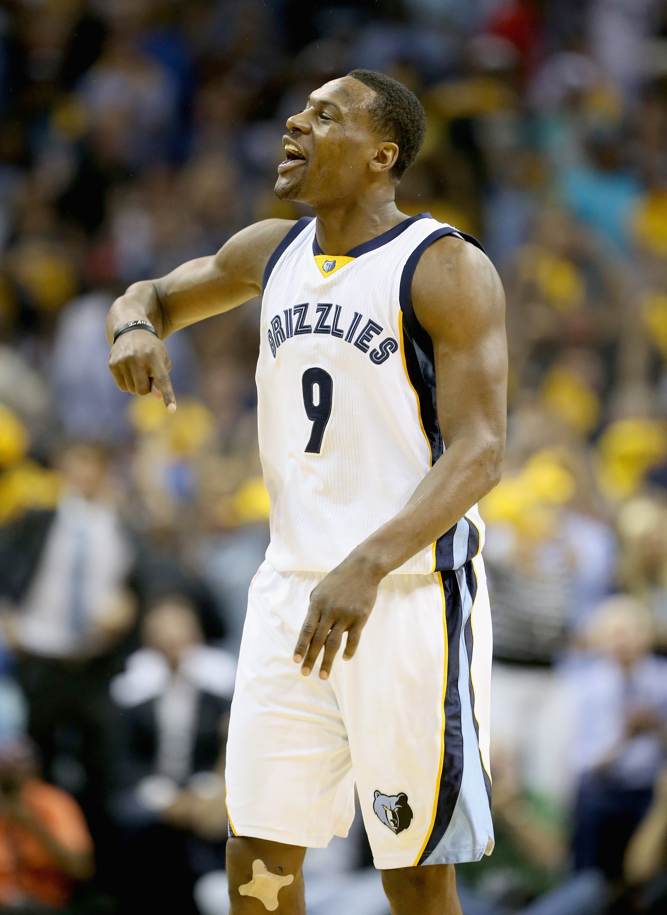 MEMPHIS, TN - MAY 09: Tony Allen #9 of the Memphis Grizzlies celebrates after making a basket against the Golden State Warriors during Game three of the Western Conference Semifinals of the 2015 NBA Playoffs at FedExForum on May 9, 2015 in Memphis, Tennessee. NOTE TO USER: User expressly acknowledges and agrees that, by downloading and or using this photograph, User is consenting to the terms and conditions of the Getty Images License Agreement (Photo by Andy Lyons/Getty Images)