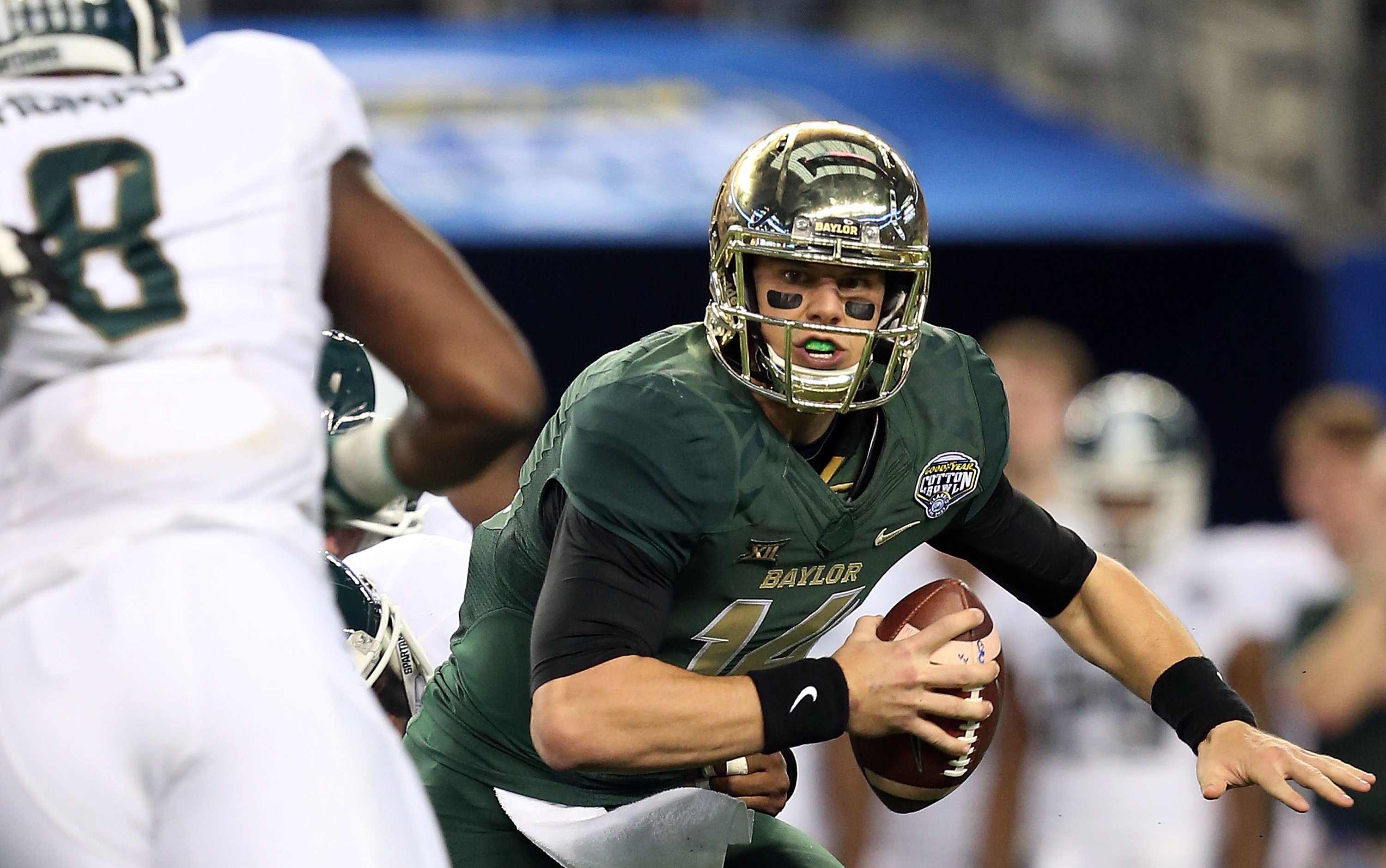 In a losing effort, Bryce Petty put on a show at the Cotton Bowl. (Getty Images)