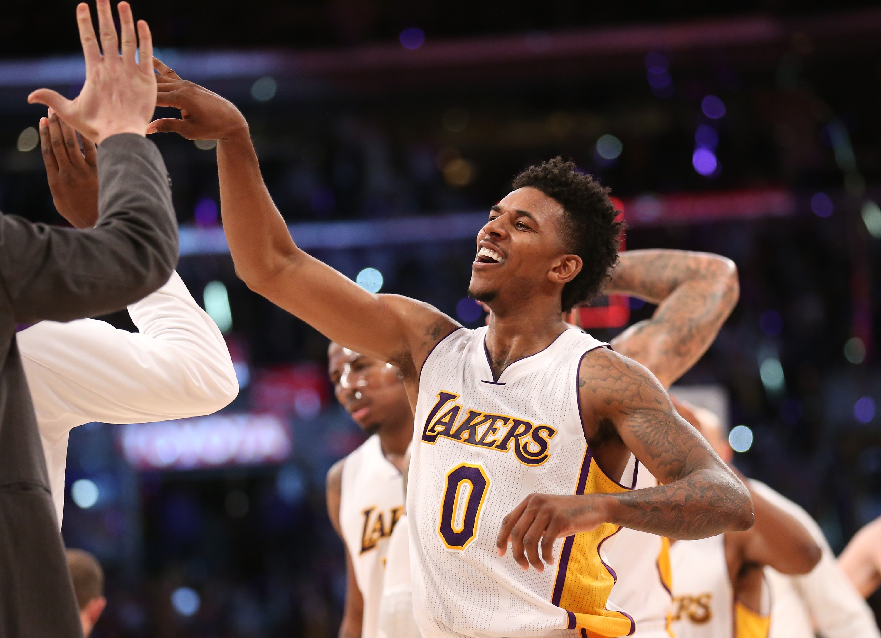 Nick Young celebrates, as is his wont. (Stephen Dunn/Getty Images)