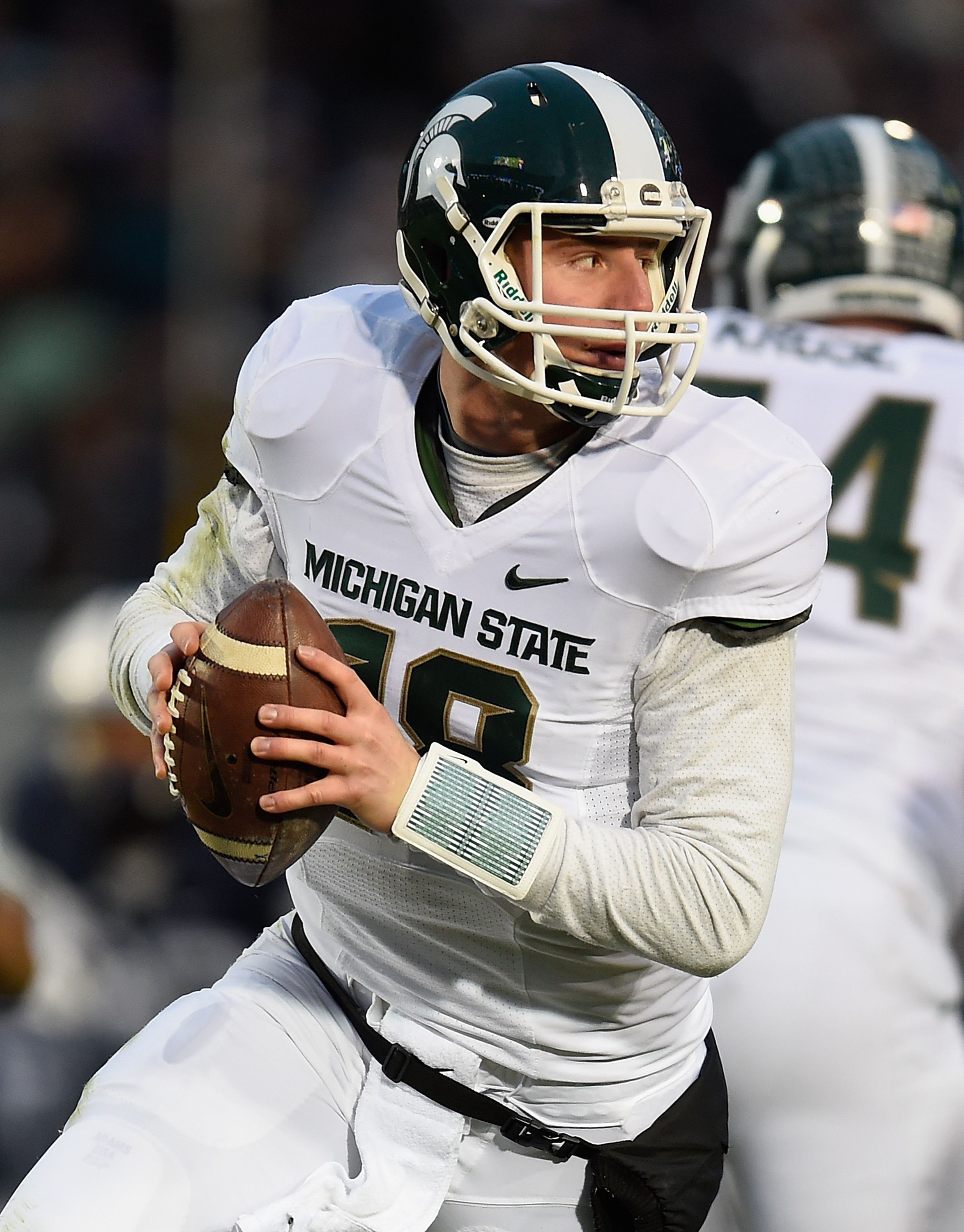 STATE COLLEGE, PA - NOVEMBER 29:  Connor Cook #18 of the Michigan State Spartans looks to pass during the second quarter against the Penn State Nittany Lions at Beaver Stadium on November 29, 2014 in State College, Pennsylvania.  (Photo by Joe Sargent/Getty Images)