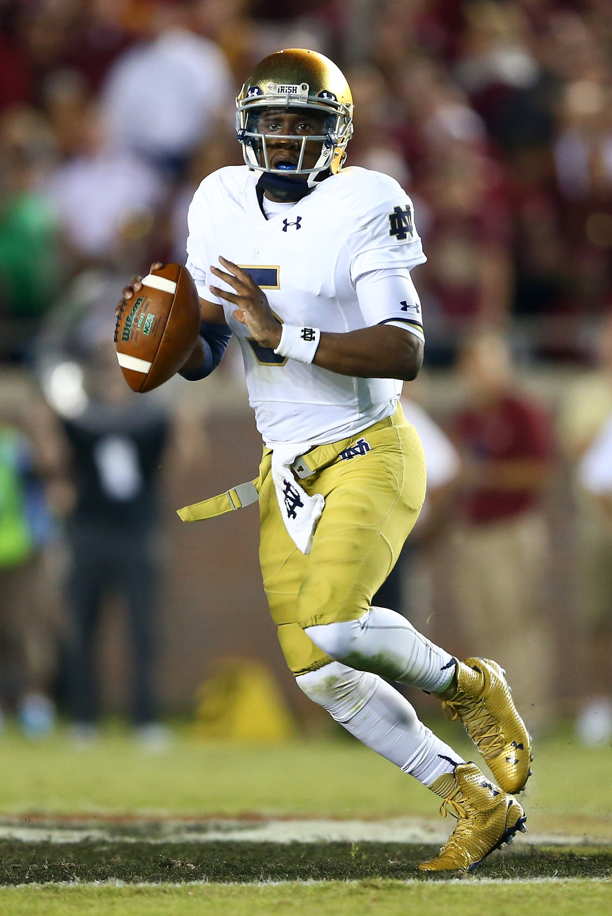 TALLAHASSEE, FL - OCTOBER 18:  Everett Golson #5 of the Notre Dame Fighting Irish drops back to pass against the Florida State Seminoles during their game at Doak Campbell Stadium on October 18, 2014 in Tallahassee, Florida.  (Photo by Streeter Lecka/Getty Images)