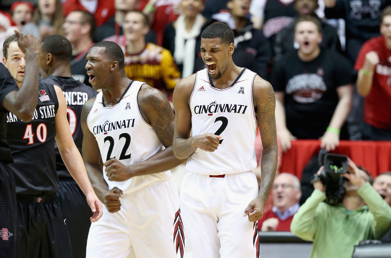 Octavius Ellis and Coreontae DeBerry of the Cincinnati Bearcats celebrate Wednesday night. (Getty Images)