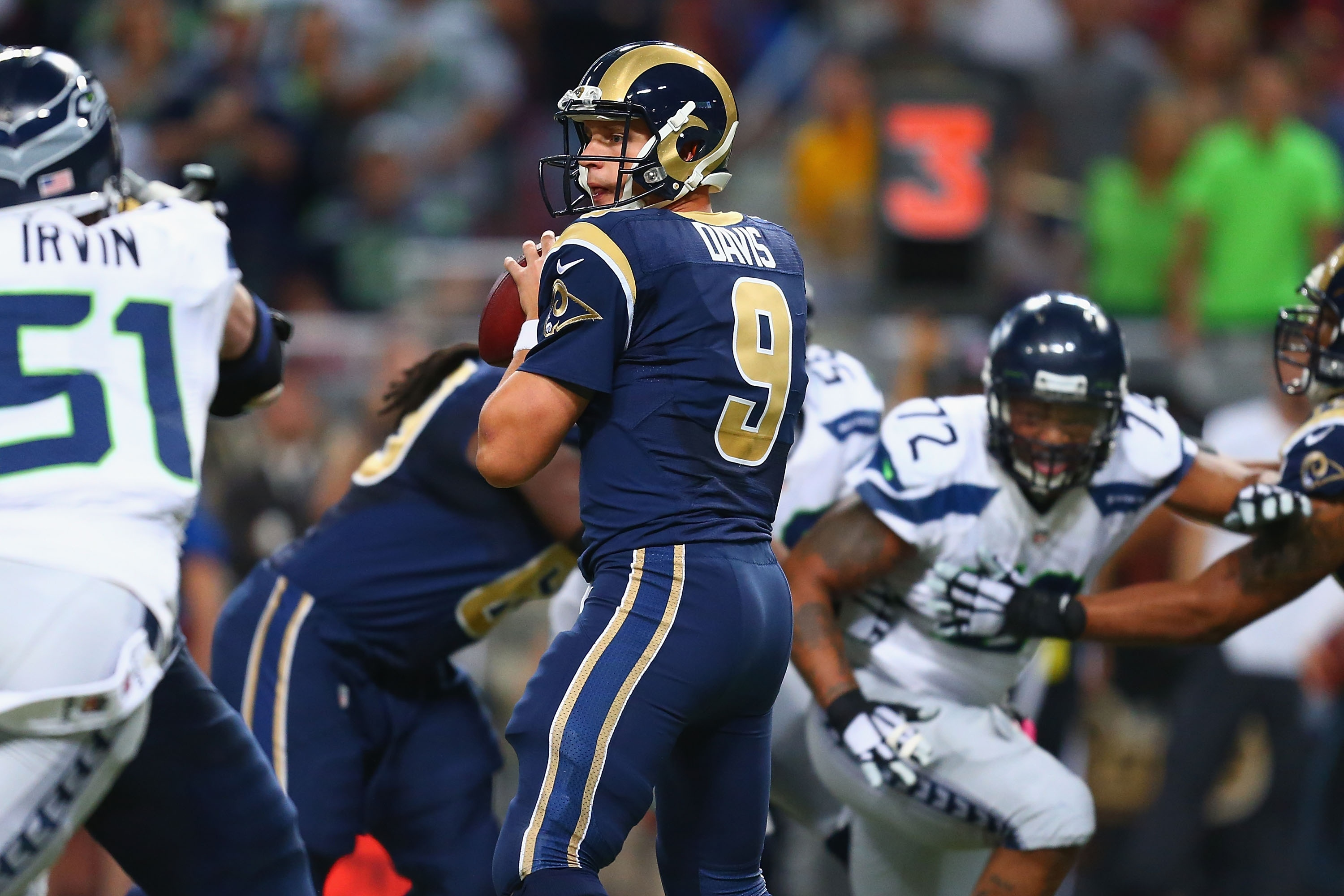 ST. LOUIS, MO - OCTOBER 19: Austin Davis #9 of the St. Louis Rams looks to pass against the Seattle Seahawks in the fourth quarter at the Edward Jones Dome on October 19, 2014 in St. Louis, Missouri.  The Rams beat the Seahawks 28-26.  (Photo by Dilip Vishwanat/Getty Images)