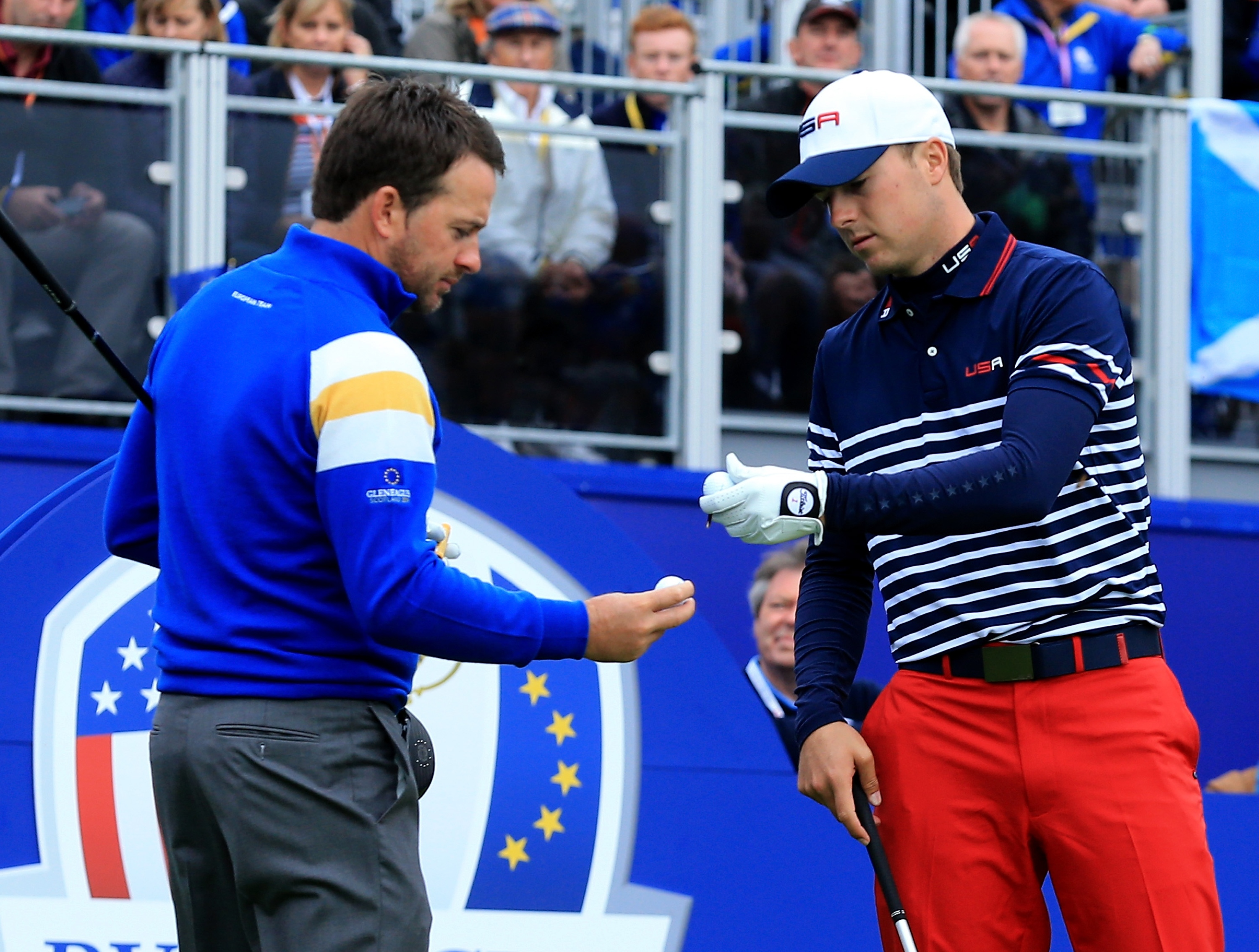AUCHTERARDER, SCOTLAND - SEPTEMBER 28: Graeme McDowell of Europe and Jordan Spieth of the United States on the 1st tee during the Singles Matches of the 2014 Ryder Cup on the PGA Centenary course at the Gleneagles Hotel on September 28, 2014 in Auchterarder, Scotland. (Photo by David Cannon/Getty Images)