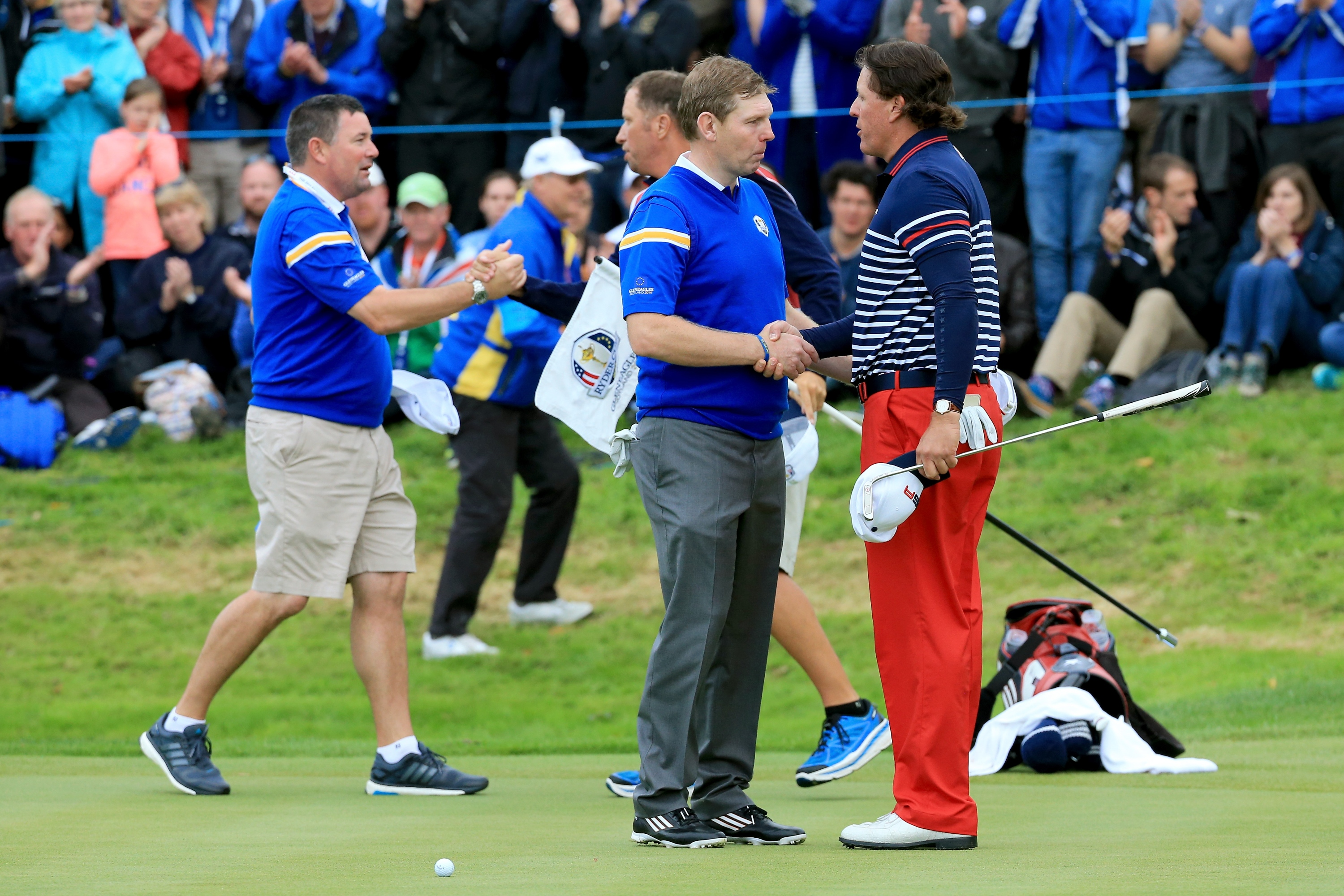 AUCHTERARDER, SCOTLAND - SEPTEMBER 28: Stephen Gallacher of Europe shakes hands with Phil Mickelson of the United States after his defeat on the 17th hole during the Singles Matches of the 2014 Ryder Cup on the PGA Centenary course at the Gleneagles Hotel on September 28, 2014 in Auchterarder, Scotland. (Photo by David Cannon/Getty Images)
