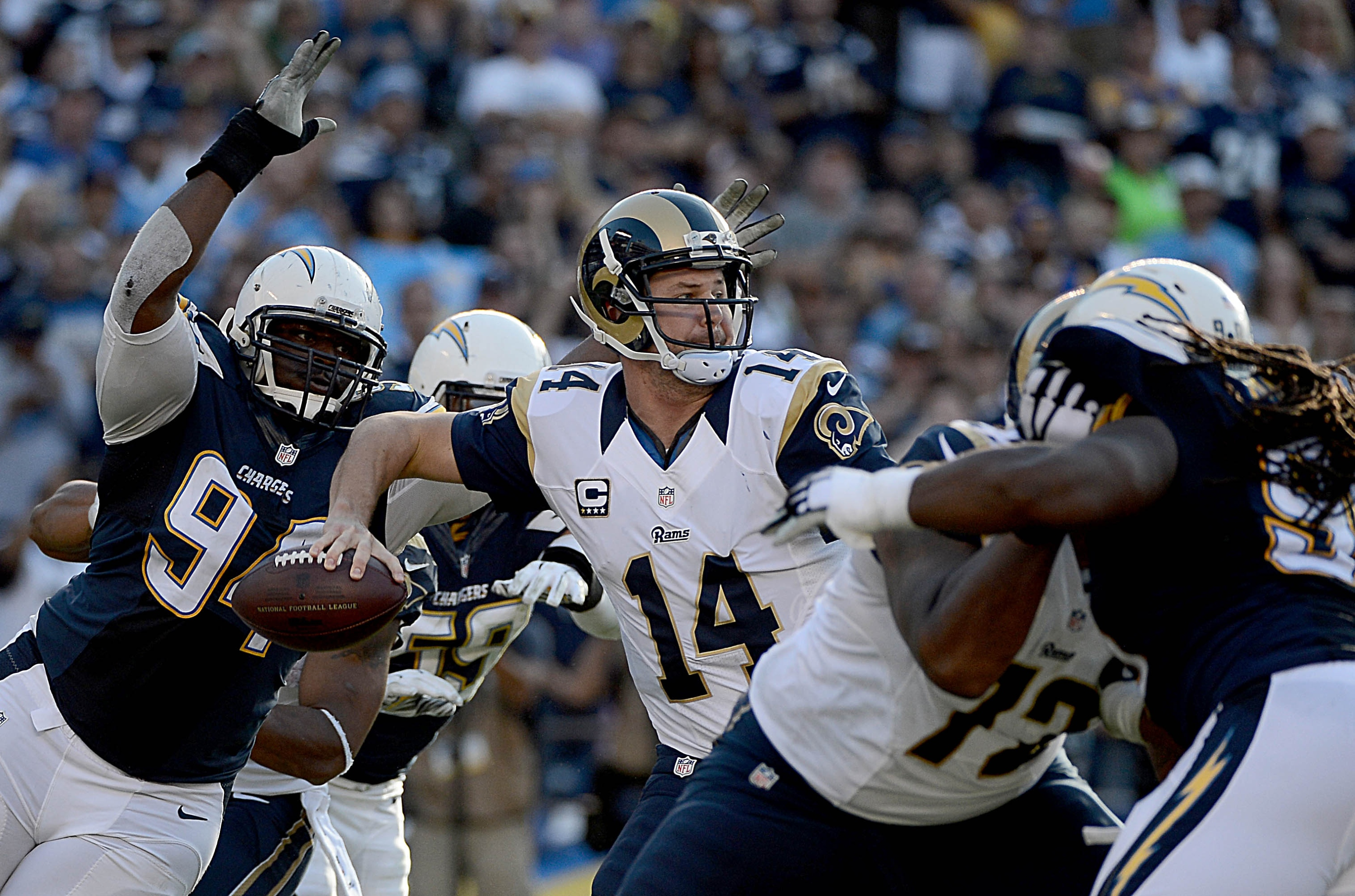 SAN DIEGO, CA- NOVEMBER 23:  Quarterback Shaun Hill #14 of the St. Louis Rams has the ball knocked out of his hand by Corey Liuget #94 of the San Diego Chargers which resulted in a fumble and touchdown during their NFL Game on November 23, 2014 in San Diego, California. (Photo by Donald Miralle/Getty Images)