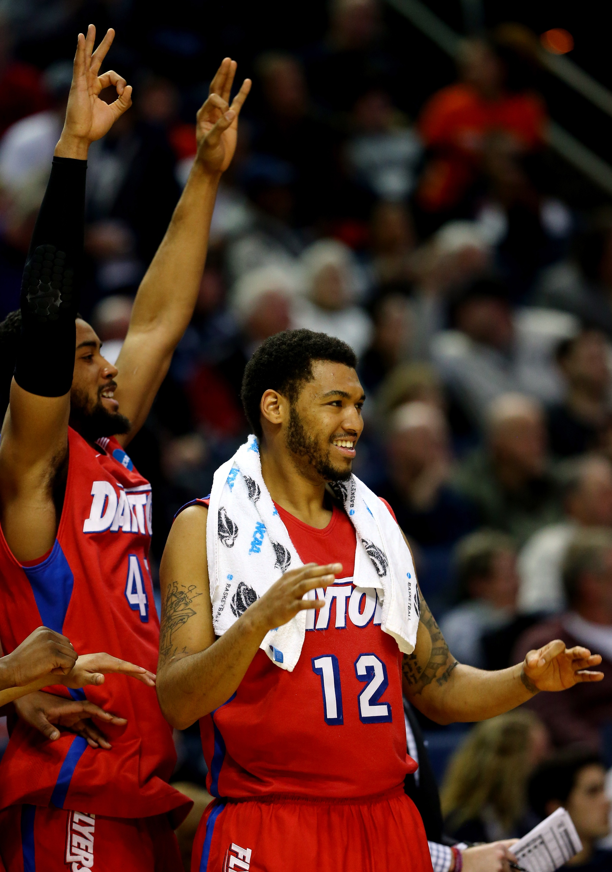 Jalen Robinson (R) and Devon Scott during a Dayton victory during the NCAA tournament. (Getty)