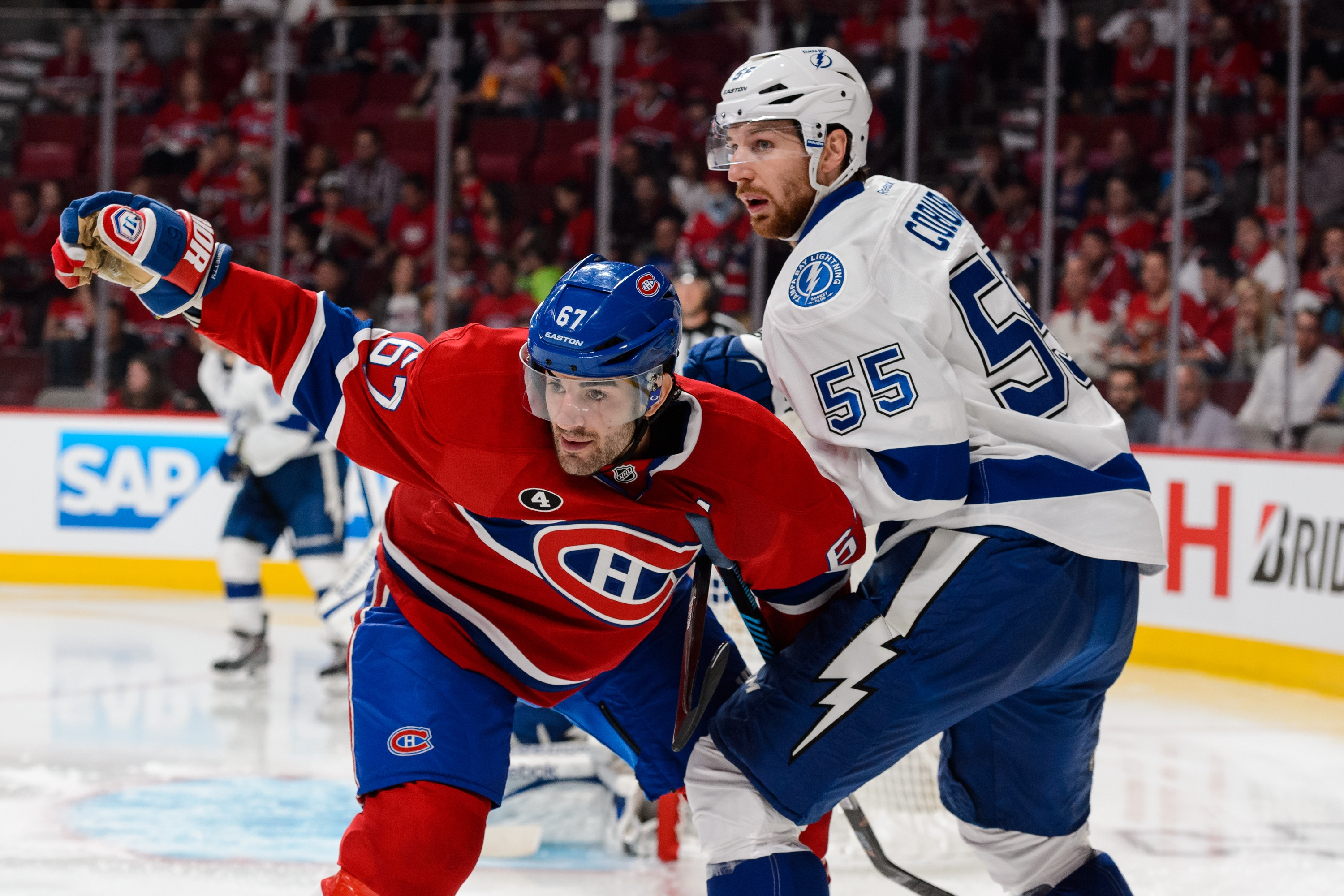 MONTREAL, QC - MAY 09:  Max Pacioretty #67 of the Montreal Canadiens gets tangled up with Braydon Coburn #55 of the Tampa Bay Lightning in Game Five of the Eastern Conference Semifinals during the 2015 NHL Stanley Cup Playoffs at the Bell Centre on May 9, 2015 in Montreal, Quebec, Canada. (Photo by Minas Panagiotakis/Getty Images)