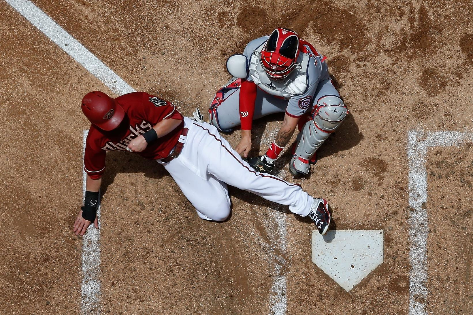 Chris Owings, safe play on a light Monday. (Photo by Christian Petersen/Getty Images)