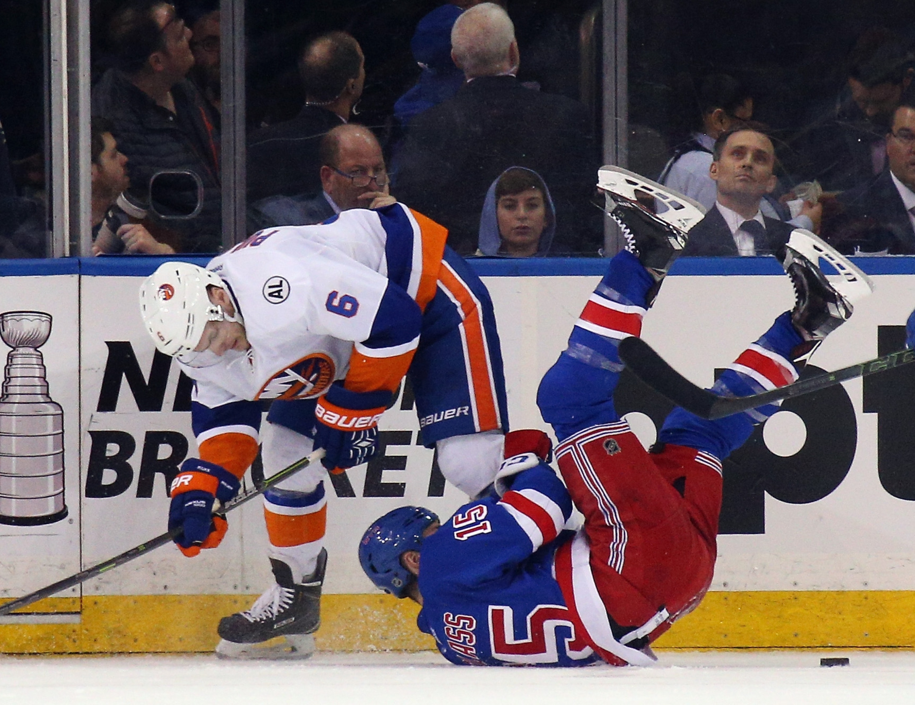NEW YORK, NY - APRIL 07: Ryan Pulock #6 of the New York Islanders and Tanner Glass #15 of the New York Rangers collide during the third period at Madison Square Garden on April 7, 2016 in New York City. The Islanders defeated the Rangers 4-1. (Photo by Bruce Bennett/Getty Images)