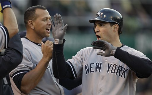 A-Rod could back up Mark Teixeira, right, at first base. (AP)