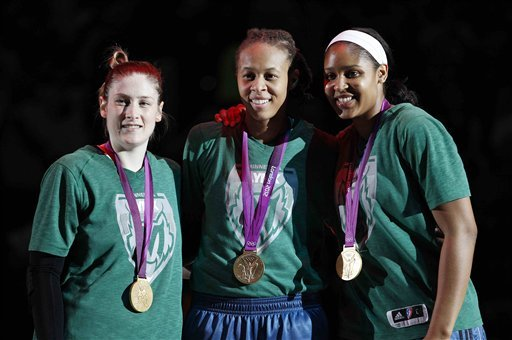 Lynx teammates Lindsay Whalen, left, Seimone Augustus, and Maya Moore won gold together at the 2012 London Olympics. (AP)