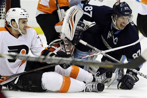 Pittsburgh Penguins center Sidney Crosby (87) and Philadelphia Flyers center Zac Rinaldo (36) collide in the second period of an NHL hockey game in Pittsburgh, Sunday, March 24, 2013. (AP Photo/Gene J. Puskar)