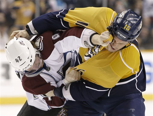 Colorado Avalanche center Brad Malone (42) fights with Nashville Predators left wing Rich Clune (16) in the first period of an NHL hockey game Tuesday, April 2, 2013, in Nashville, Tenn. (AP Photo/Mark Humphrey)