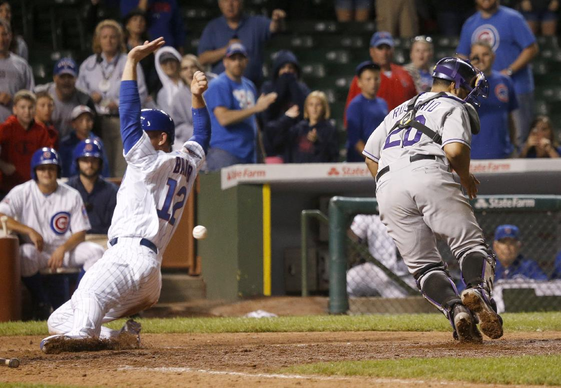Cubs beat Rockies in 16 innings with catcher John Baker pitchin…