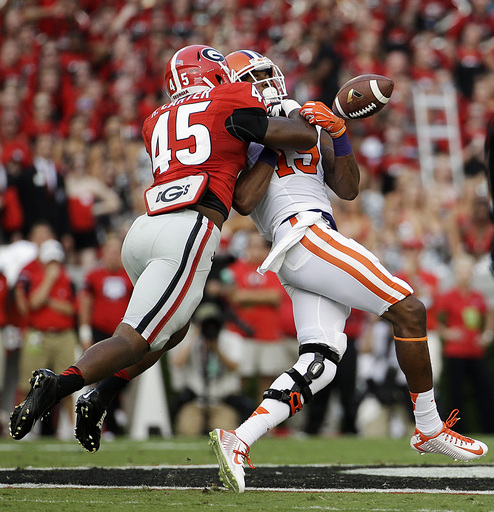 Georgia's Reggie Carter, left, breaks up a pass intended for Clemson's Charone Peake in the first half of an NCAA college football game, Saturday, Aug. 30, 2014, in Athens, Ga. (AP Photo/David Goldman)