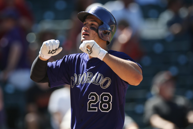 Nolan Arenado, clearing bases. (AP Photo/David Zalubowski)