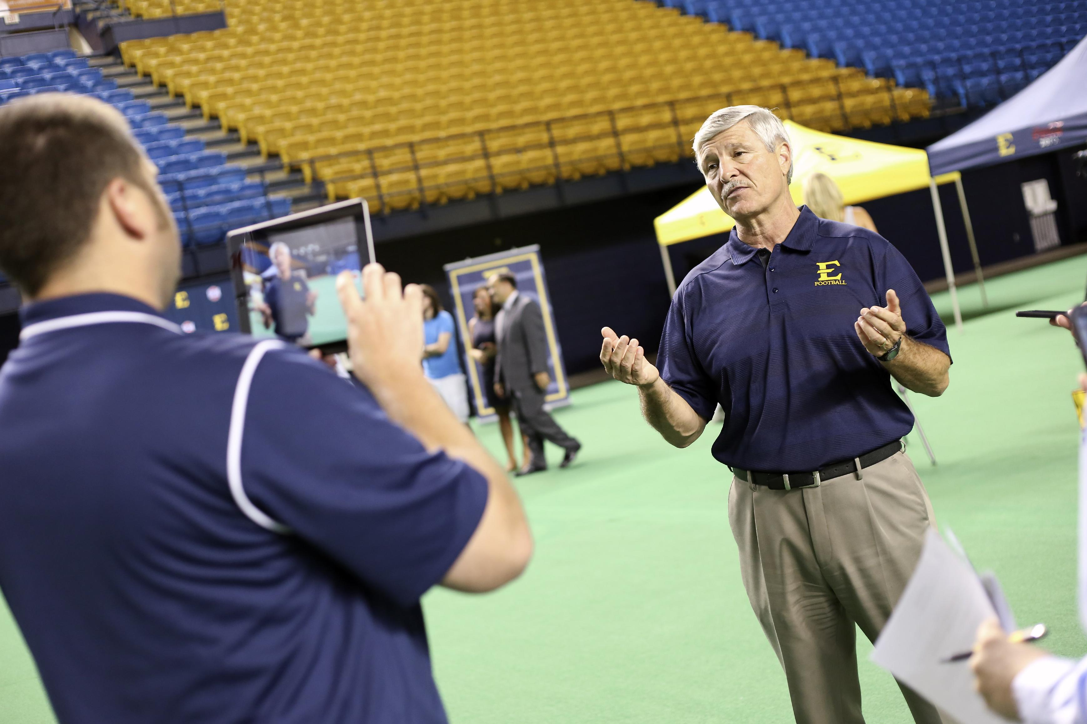 In this Sept. 3, 2014 photo, East Tennessee State head coach Carl Torbush talks to the media during the school's NCAA college football media day in Johnson City, Tenn. (AP Photo/East Tennessee State, Ron Campbell)