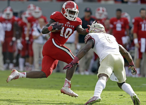 Florida State's Tyler Hunter (1) looks to tackle North Carolina State's Shadrach Thornton (10) during the first half of an NCAA college football game in Raleigh, N.C., Saturday, Sept. 27, 2014. (AP Photo/Gerry Broome)