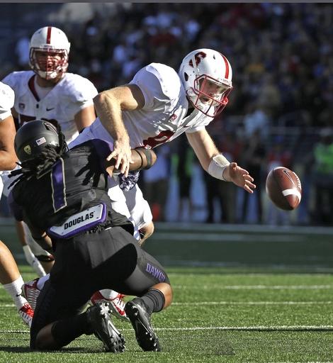 Stanford quarterback Kevin Hogan fumbles, forced by Washington's Shaq Thompson (AP Photo/Elaine Thompson)