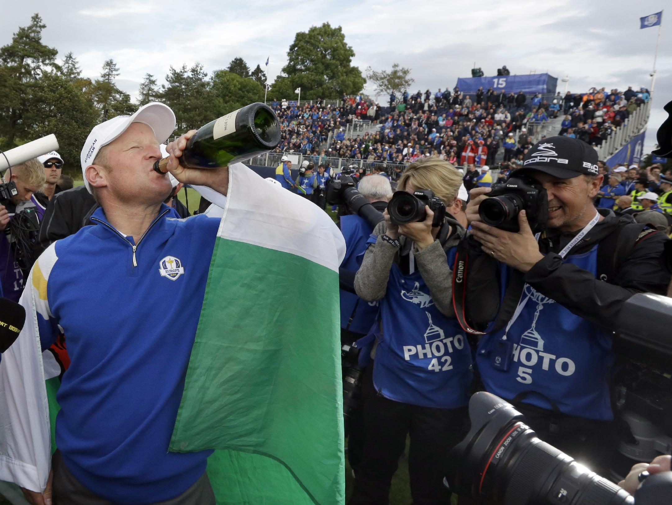 Europe's Jamie Donaldson drinks from a champagne bottle to celebrate his singles match to win the 2014 Ryder Cup golf tournament at Gleneagles, Scotland, Sunday, Sept. 28, 2014. (AP Photo/Matt Dunham)