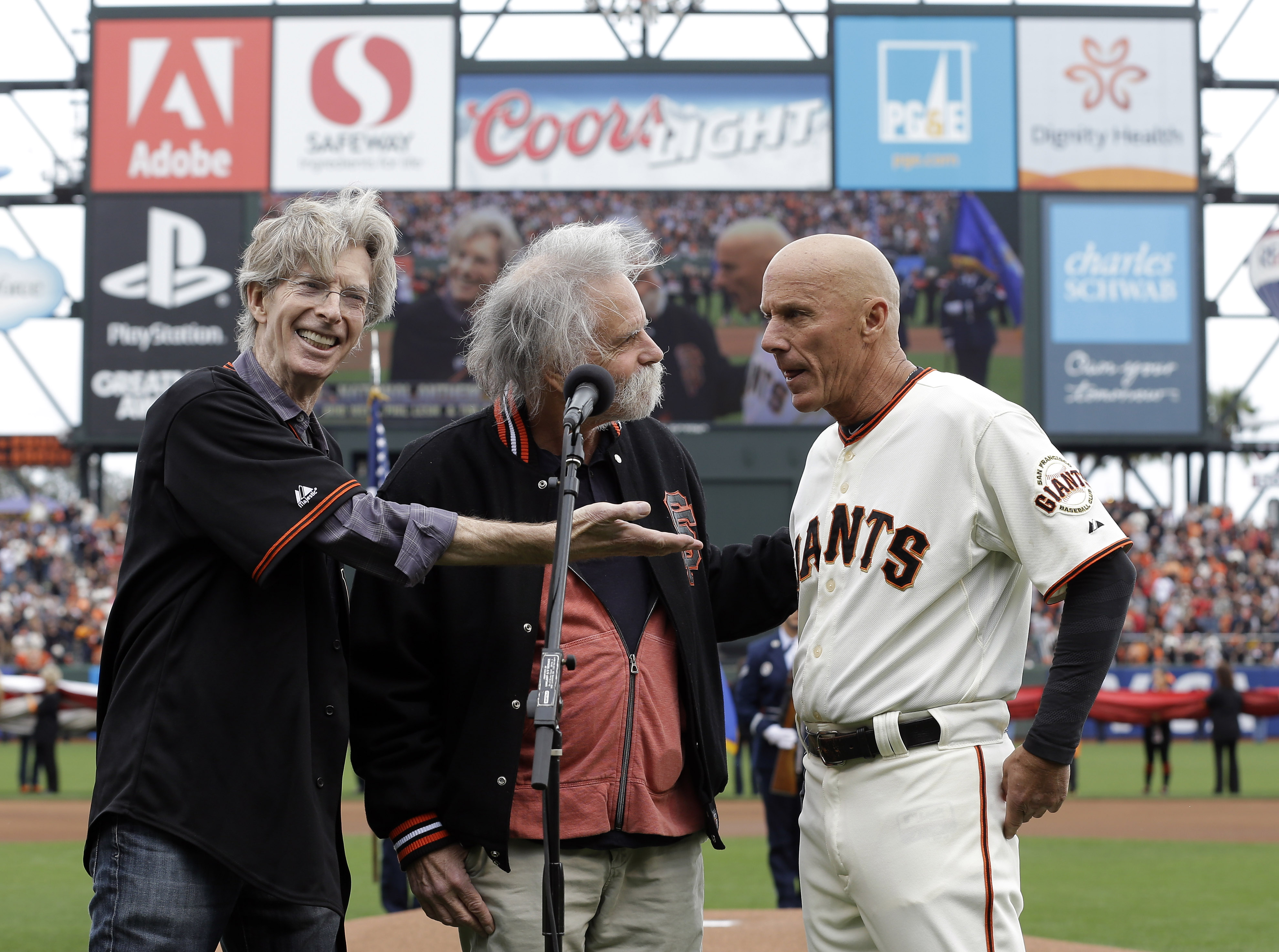 Tim Flannery (far right) joins the Grateful Dead's Phil Lesh, and Bob Weir for the national anthem. (AP)