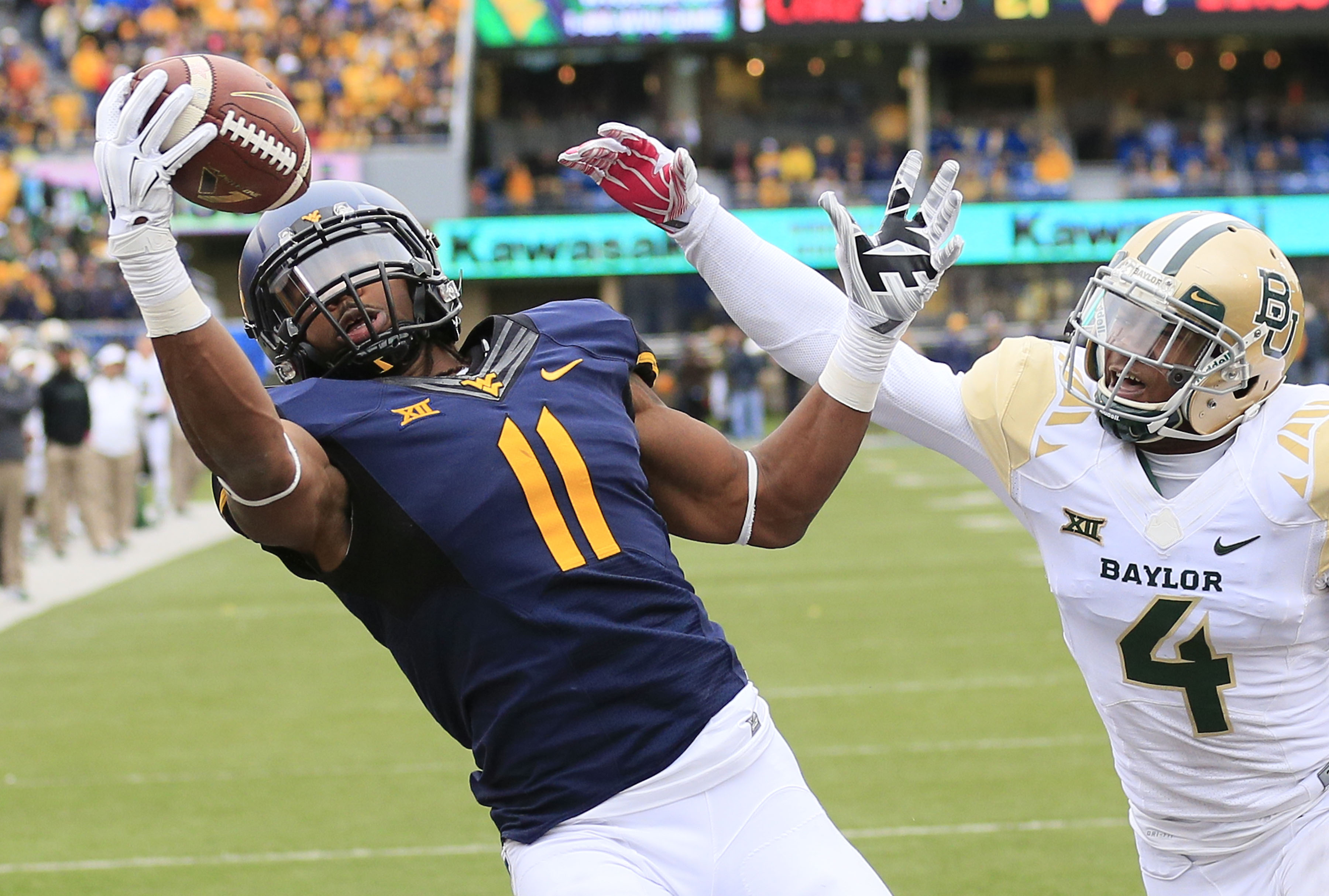 West Virginia's Kevin White (11) catches a pass for a touchdown against Baylor. (AP)