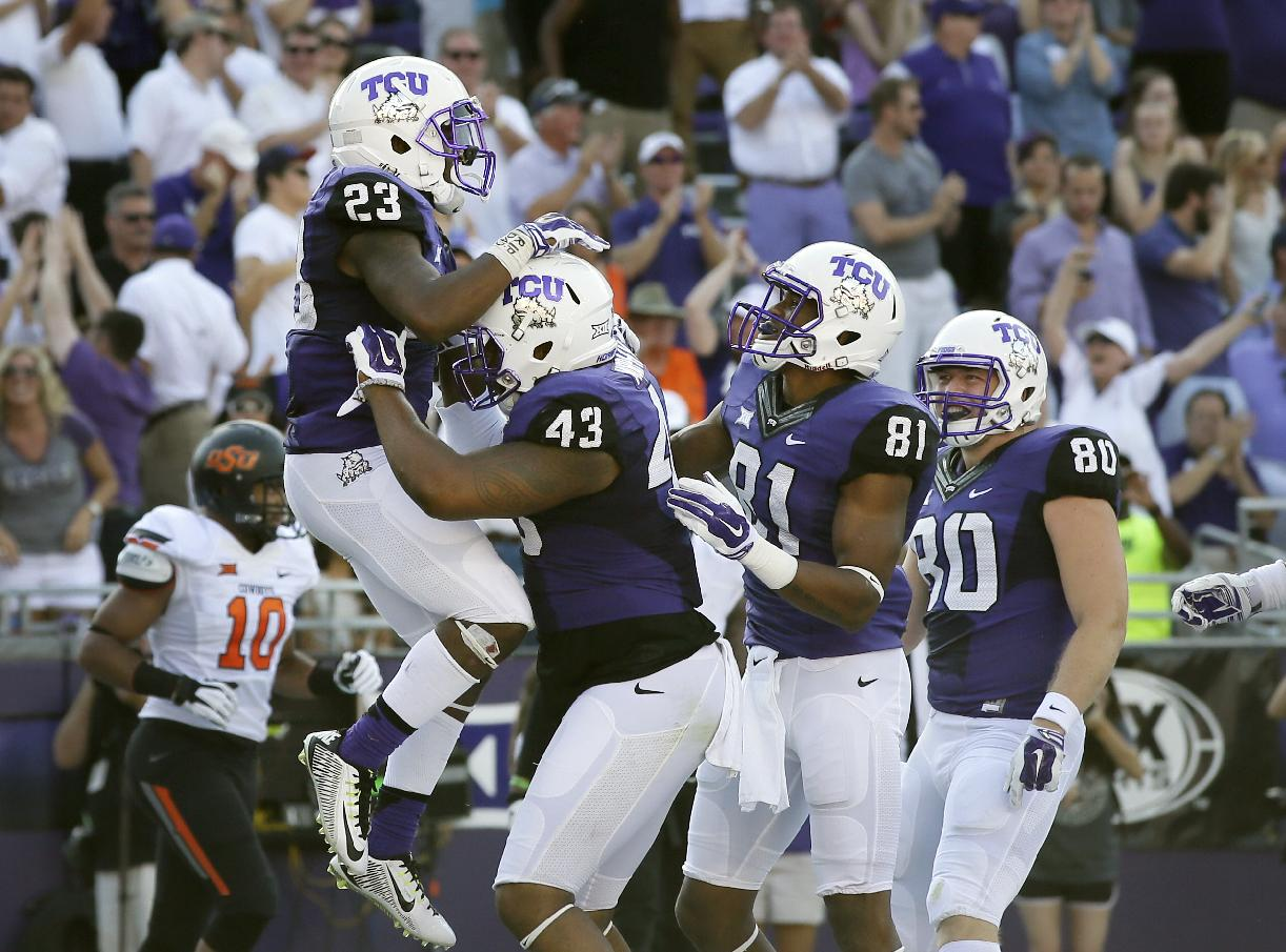 TCU running back B.J. Catalon (23) celebrates with teammates after scoring against Oklahoma State. (AP)