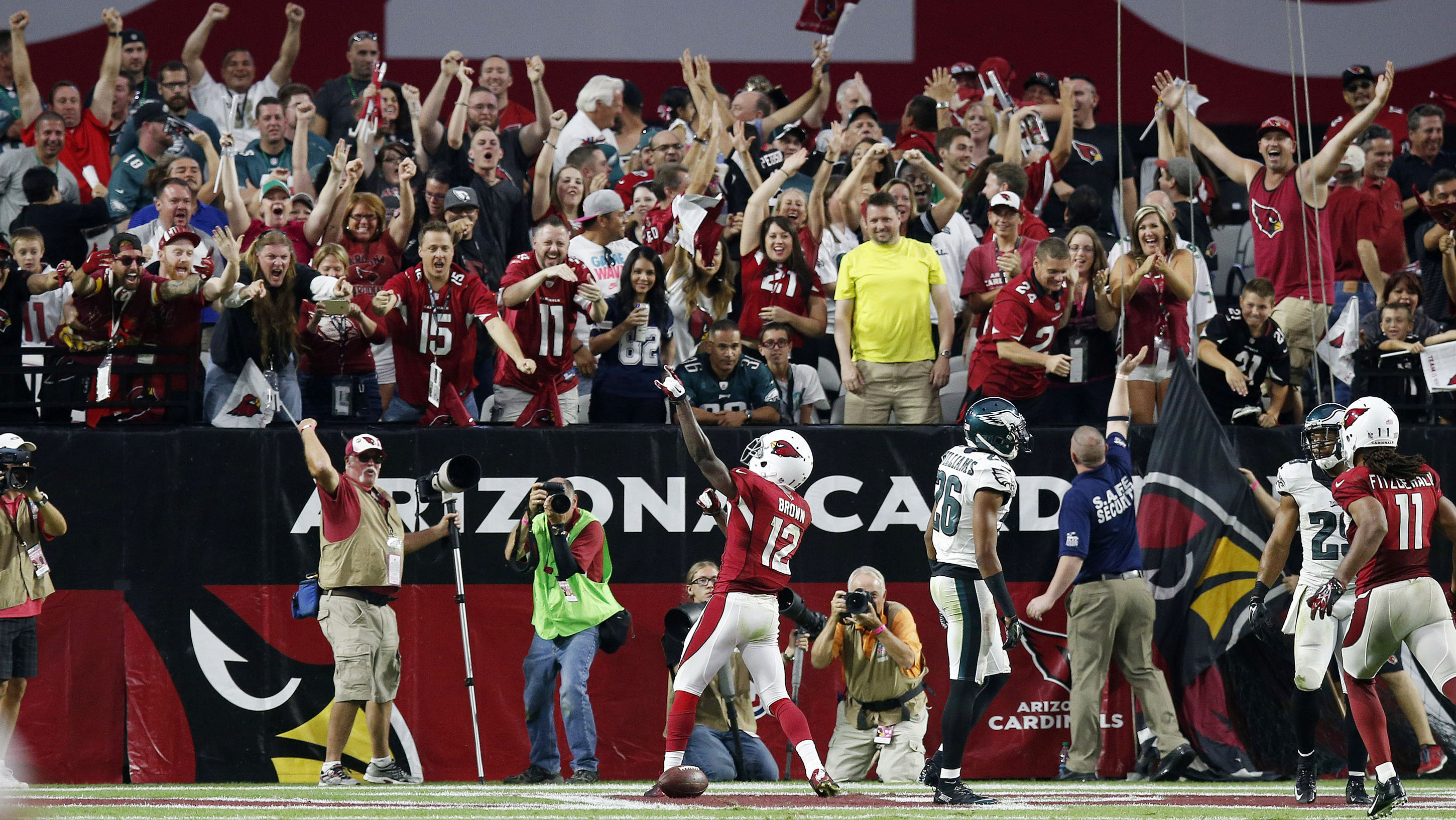 John Brown (12) celebrates his game-winning touchdown with fans. (AP)