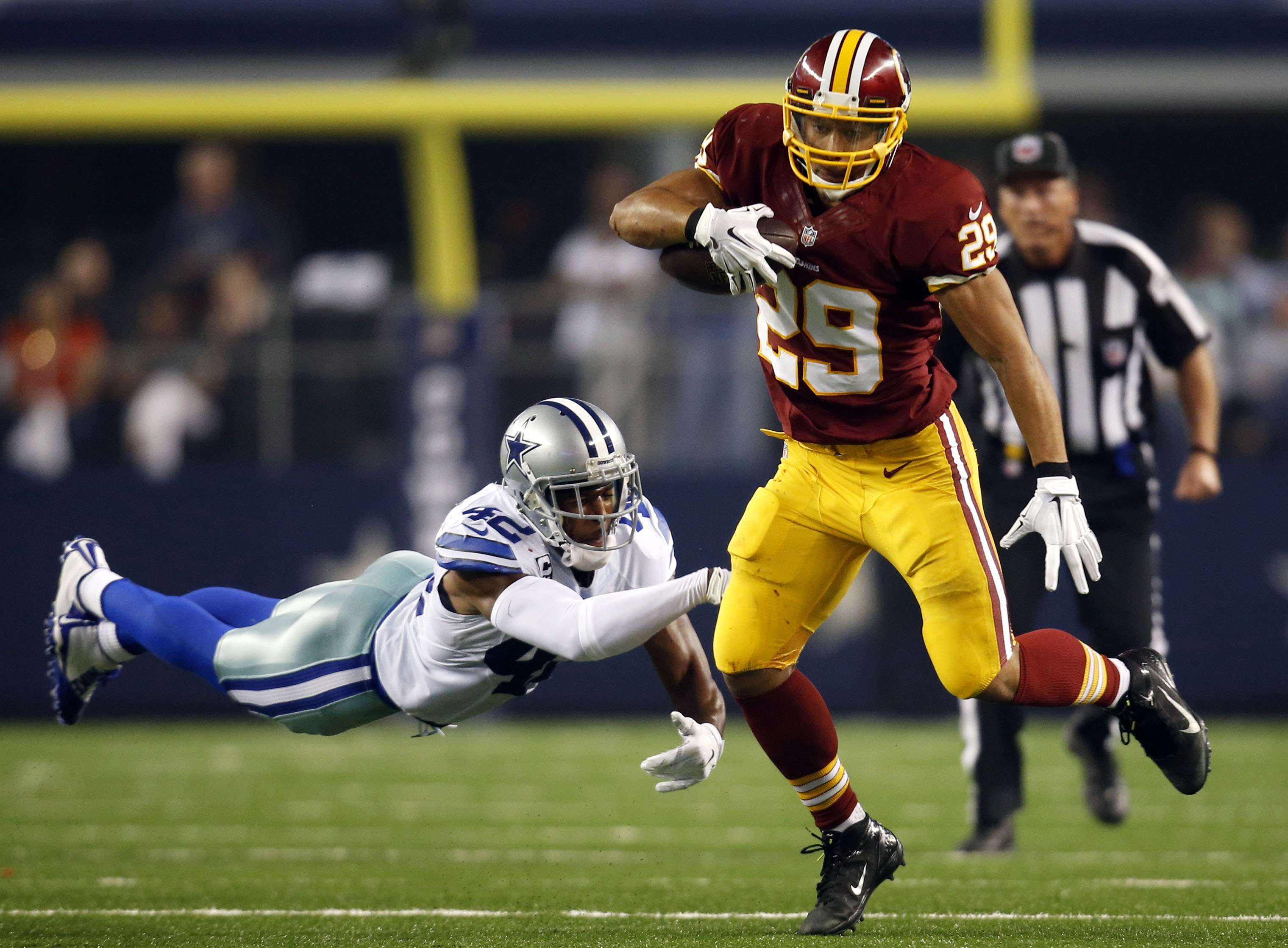 Roy Helu carries the ball last season with the Redskins. (AP Photo/Tim Sharp)