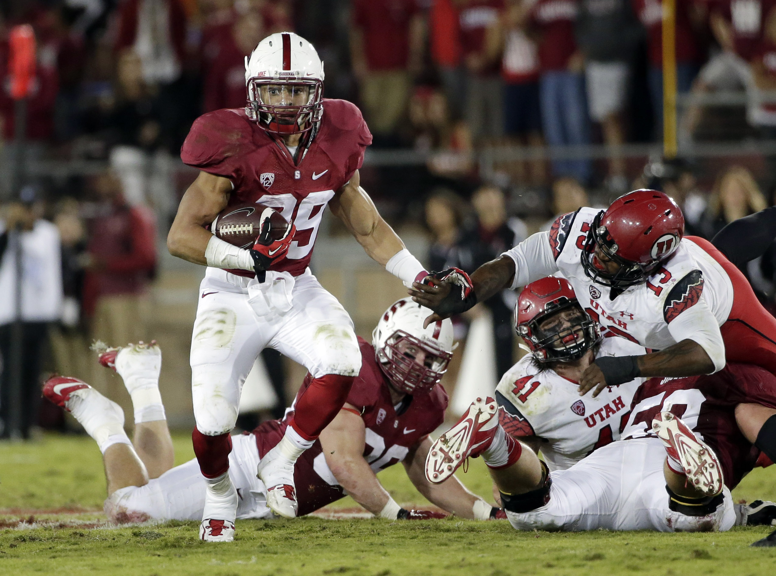 Stanford running back Kelsey Young runs against Utah during the second half of an NCAA college football game on Saturday, Nov. 15, 2014, in Stanford, Calif. Utah won 20-17 in overtime. (AP Photo/Marcio Jose Sanchez)
