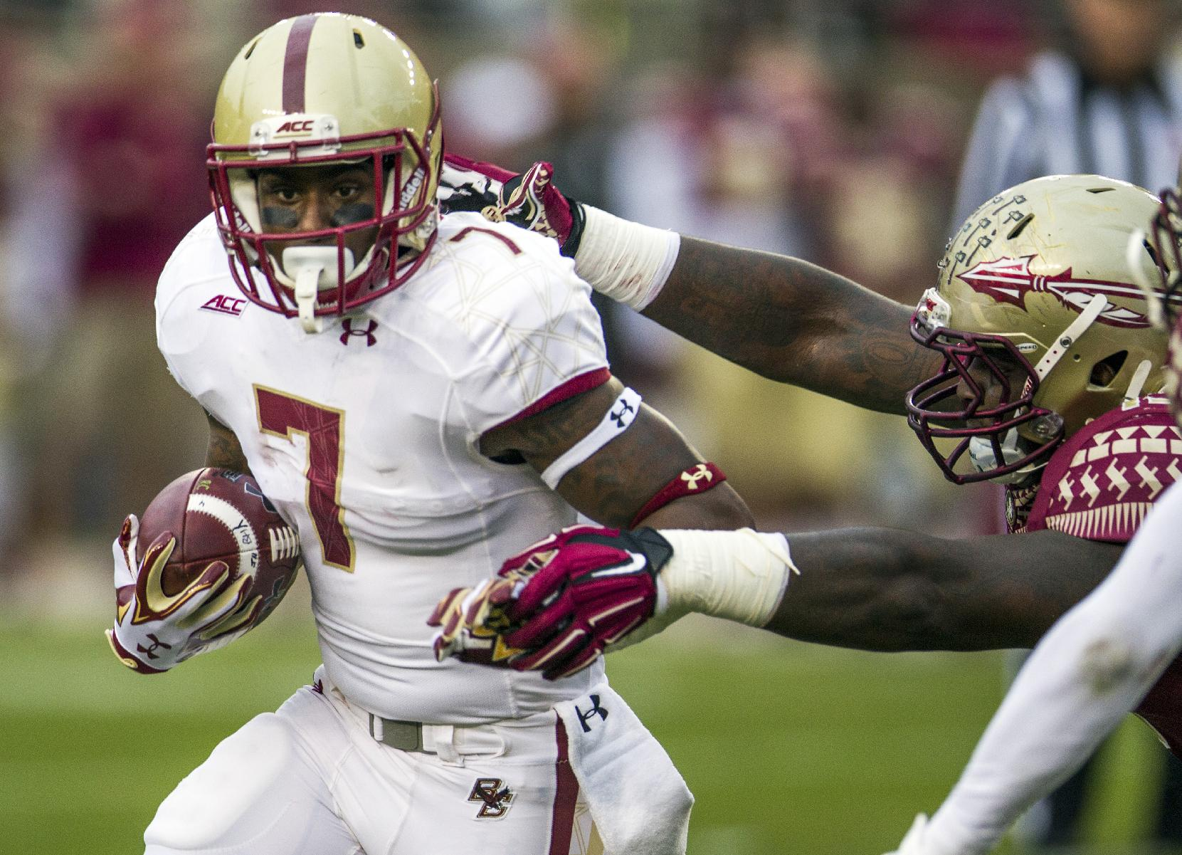 Boston College running back Marcus Outlow, left, breaks a tackle by Florida State Mario Edwards Sr. during the first half of an NCAA college football game in Tallahassee, Fla., Saturday, Nov. 22, 2014. (AP Photo/Mark Wallheiser)