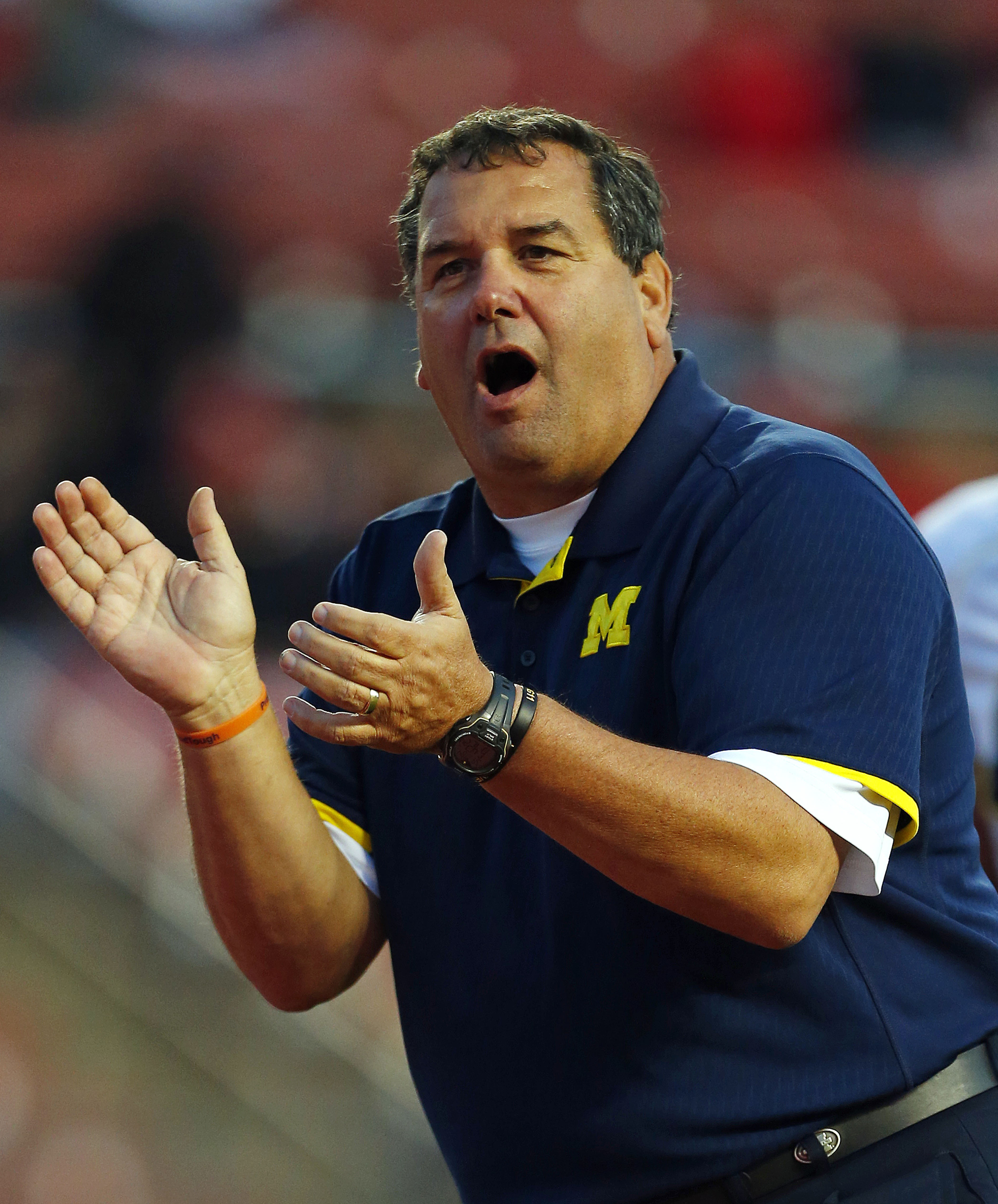 FILE - In this Oct. 4, 2014, file photo, Michigan head coach Brady Hoke looks on before an NCAA college football game against Rutgers in Piscataway, N.J. A person with knowledge of the situation says embattled Michigan football coach Brady Hoke and interim athletic director Jim Hackett are set to meet on Tuesday, Dec. 2, 2014. The person spoke on condition of anonymity because the school has not made any announcement about the meeting.(AP Photo/Rich Schultz, File)