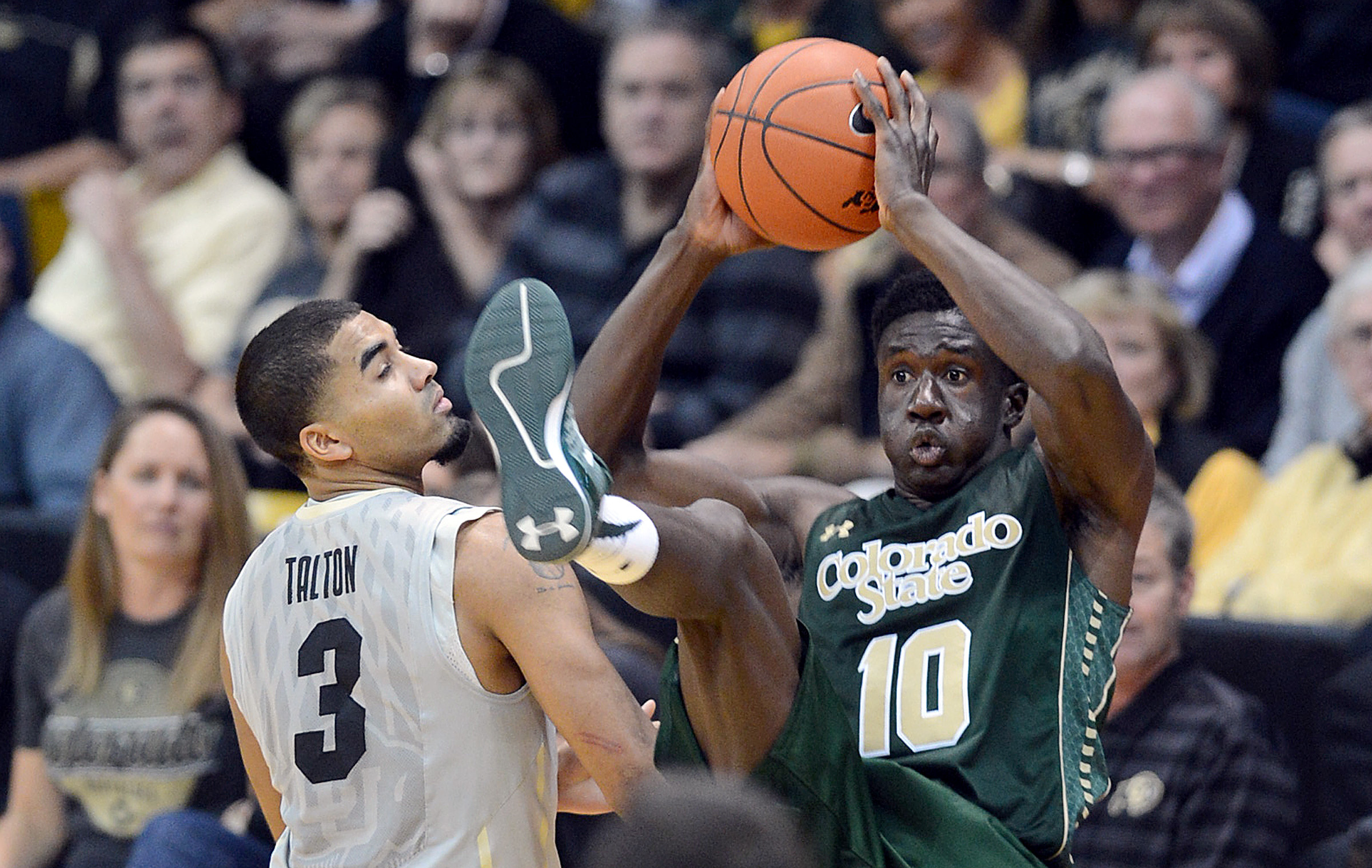 Colorado State's Joe De Ciman,(10) intercepts a pass meant for Colorado's Xavier Talton, left, during the second half of an NCAA college basketball game, Wednesday, Dec. 10, 2014 in Boulder, Colo. (AP Photo/The Daily Camera, Cliff Grassmick)