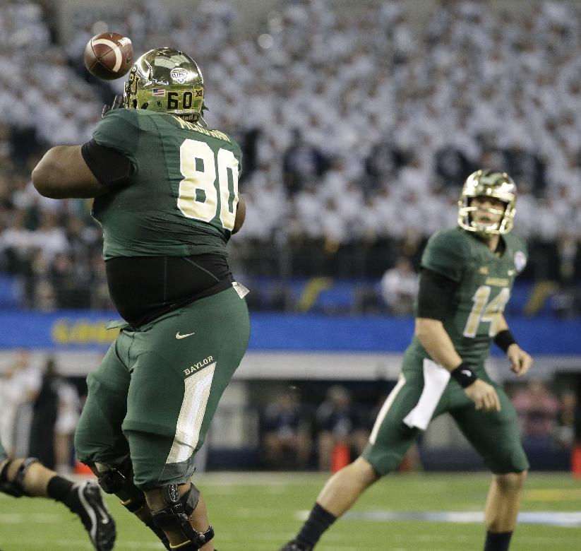 Baylor offensive guard LaQuan McGowan (80) catches a touchdown pass from quarterback Bryce Petty (14) during the second half of the Cotton Bowl NCAA college football game against Michigan State Thursday, Jan. 1, 2015, in Arlington, Texas. (AP Photo/LM Otero)