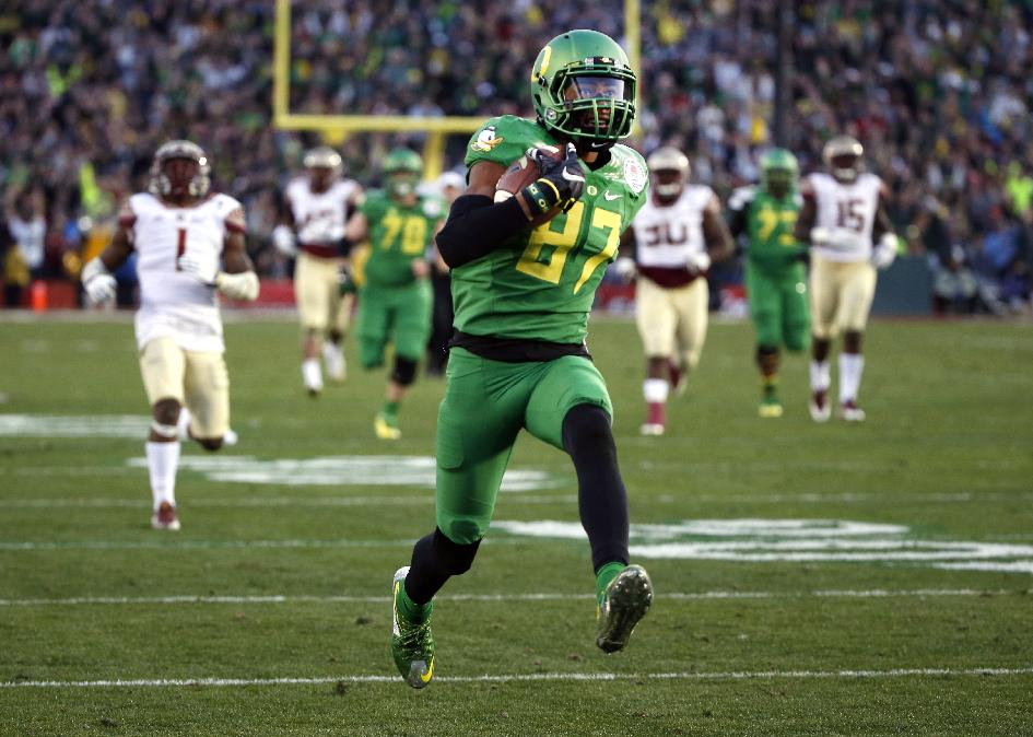 FILE - In this Jan. 1, 2015, file photo, Oregon wide receiver Darren Carrington scores against Florida State during the second half of the Rose Bowl NCAA college football playoff semifinal in Pasadena, Calif. Carrington did not travel with the Ducks to the national championship game, according to a person with knowledge of his absence. The person, who is traveling with the team, spoke to The Associated Press on Friday, Jan. 9, 2015, on condition of anonymity because the individual was not authorized to speak on the record. A spokesman for the team did not immediately respond to email inquiries seeking comment. (AP Photo/Lenny Ignelzi, File)