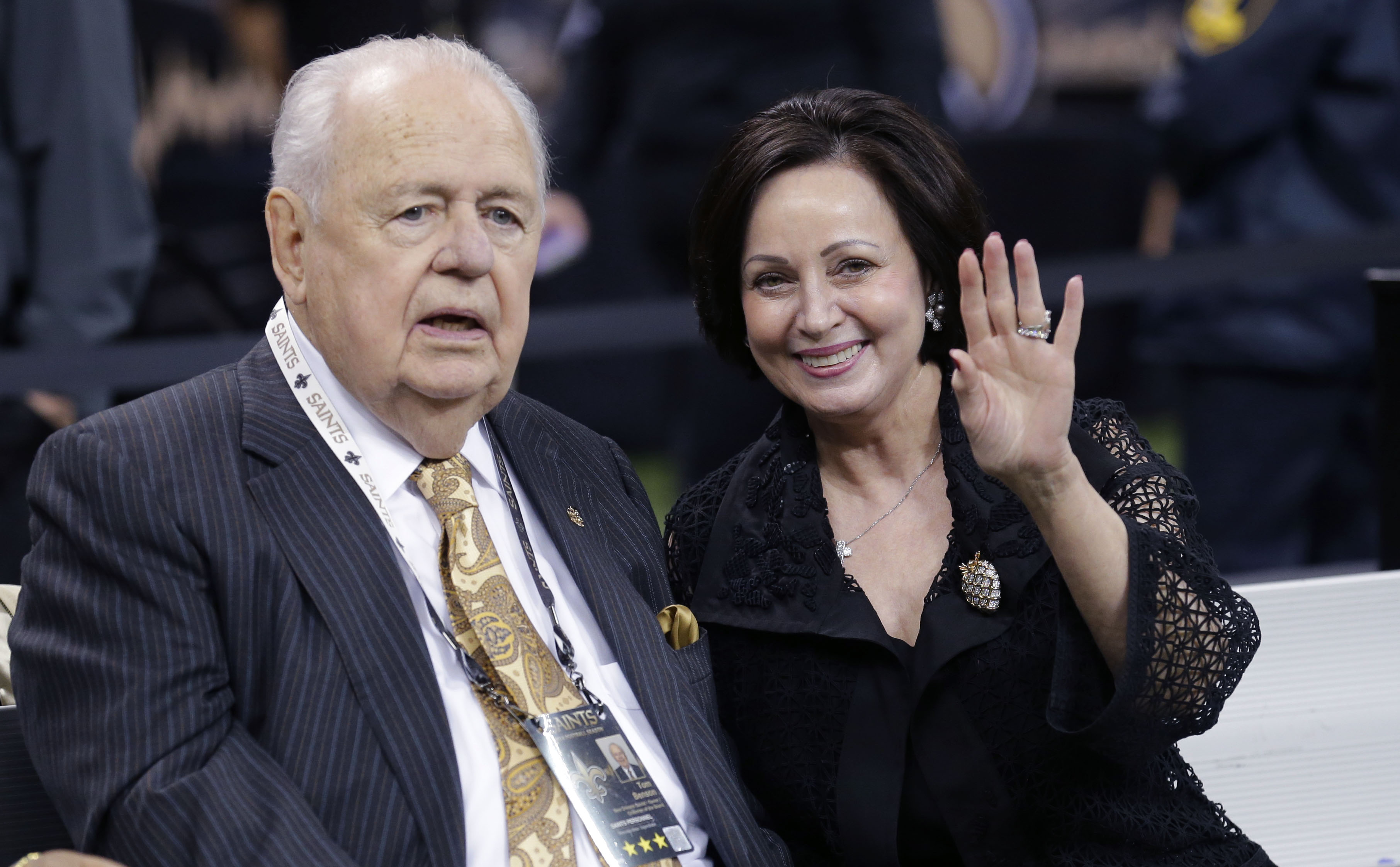 FILE - In this Oct. 26, 2014, file photo, New Orleans Saints owner Tom Benson sits on the sideline with his wife Gayle Benson. (AP Photo/Bill Haber, File)