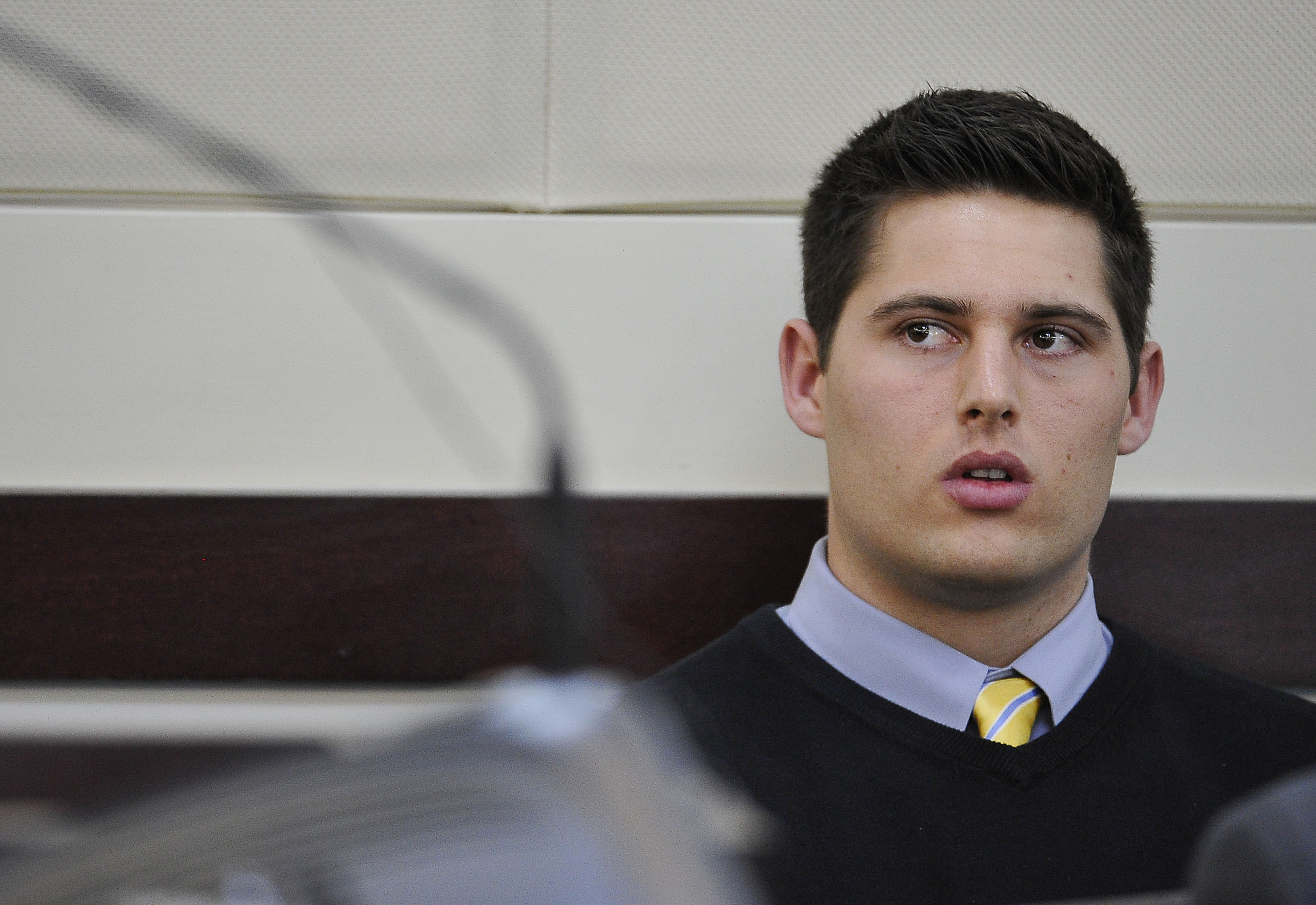 Defendant Brandon Vandenburg listens as his attorney Fletcher Long argues for acquittal during the his trial Monday, Jan. 26, 2015, in Nashville, Tenn. Tenn. Former Vanderbilt football players Vandenburg and Cory Batey are standing trial on five counts of aggravated rape and two counts of aggravated sexual battery. (AP Photo/Larry McCormack, Pool